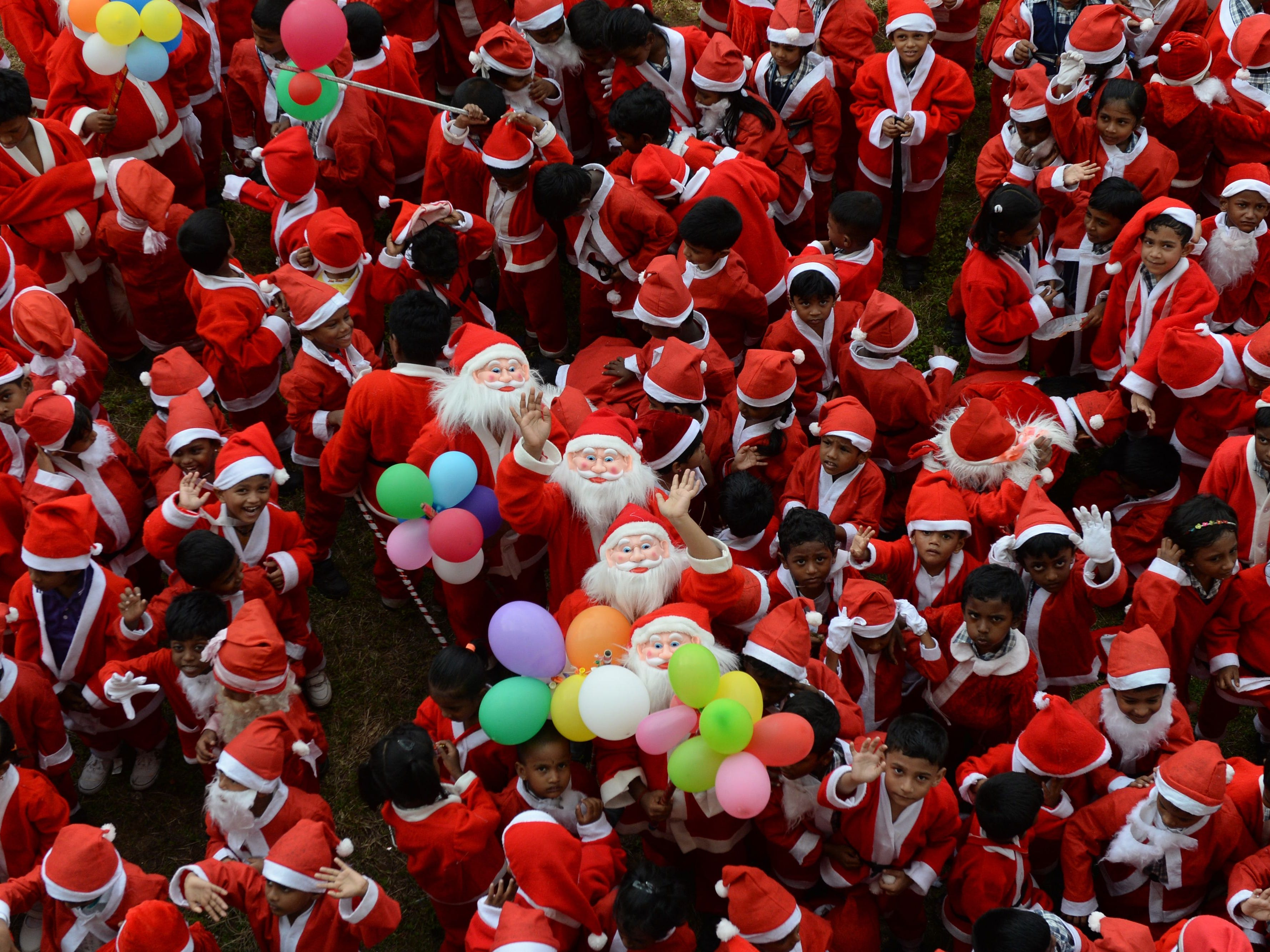 Indian schoolchildren dressed as Santa Claus take part in a Christmas event at a school in Chennai, India, Dec. 5, 2018.