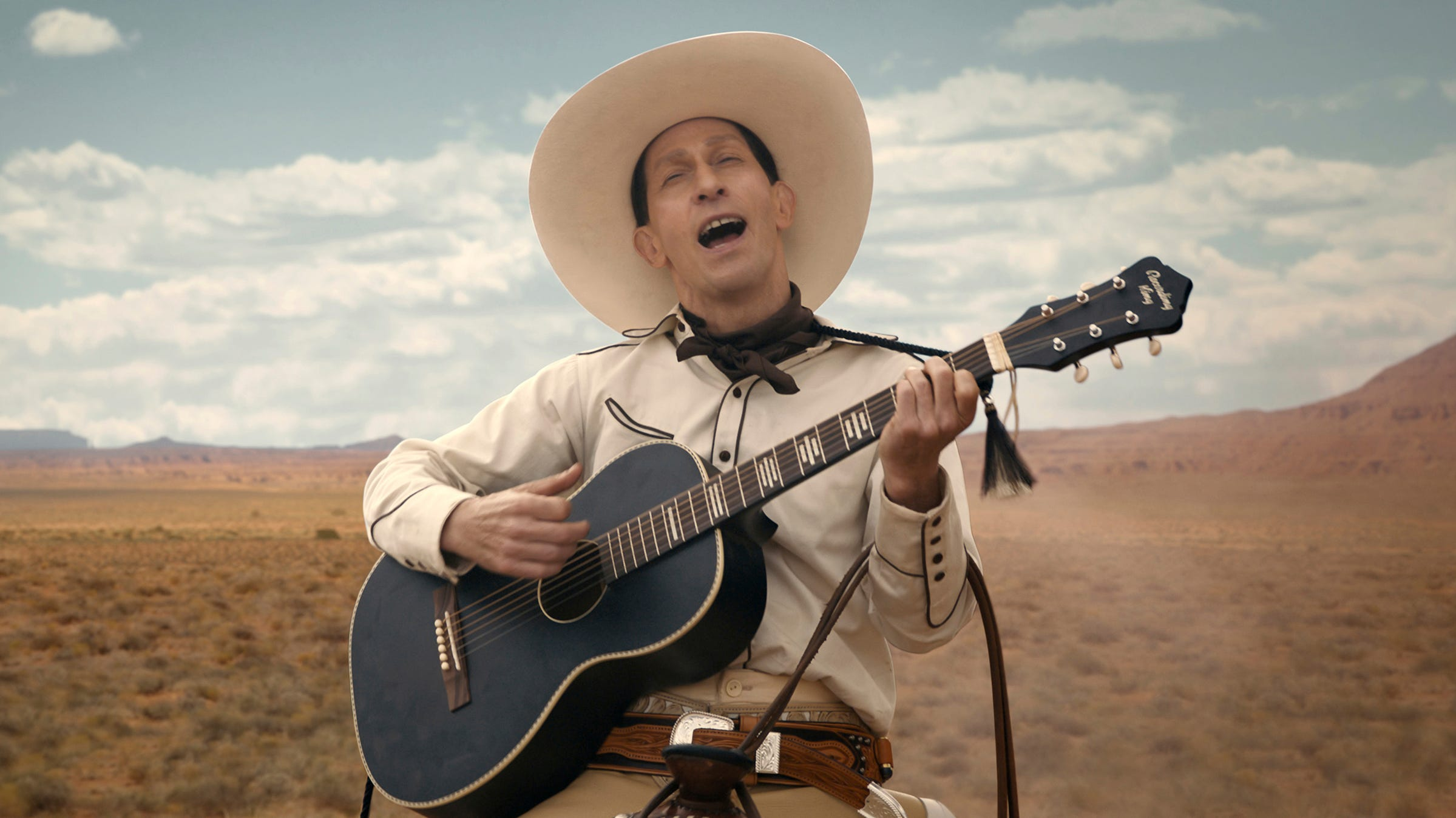 """This image released by Netflix shows Tim Blake Nelson as Buster Scruggs in a scene from """"The Ballad of Buster Scruggs,"""" a film by Joel and Ethan Coen."""