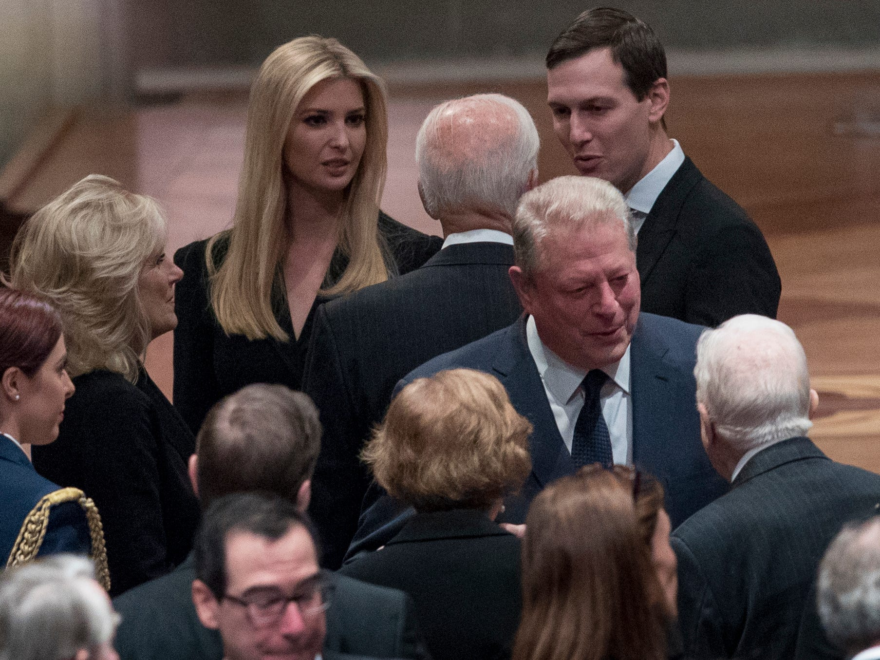 Former Vice President Joe Biden, fourth from left, and his wife Jill Biden, second from left, speak with Ivanka Trump, the daughter of President Donald Trump, third from left, and her husband, President Donald Trump's White House Senior Adviser Jared Kushner, third from right, as former Vice President Al Gore, second from right, speak to former President Jimmy Carter, right, and former first lady Rosalynn Carter, bottom center, before a State Funeral for former President George H.W. Bush at the National Cathedral, Wednesday, Dec. 5, 2018, in Washington.