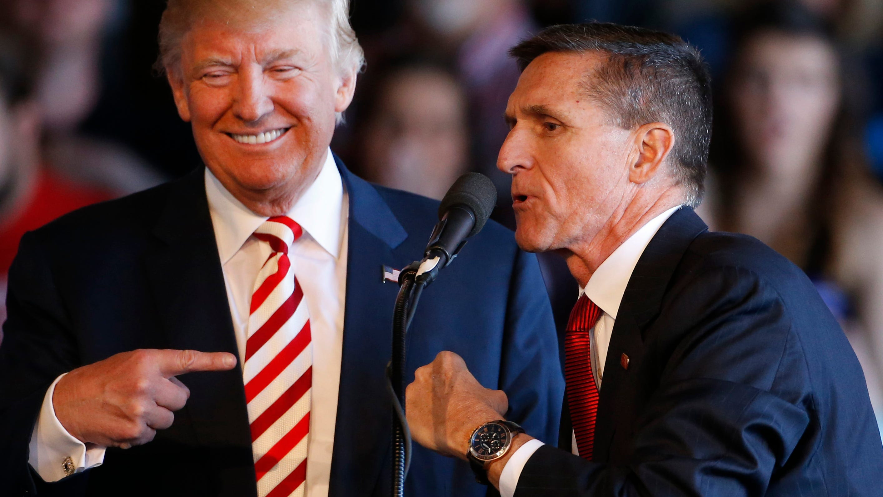 Former Trump national security adviser Michael Flynn (right) is pictured with Donald Trump during rally at Grand Junction Regional Airport on Oct. 18, 2016 in Grand Junction, Colorado.