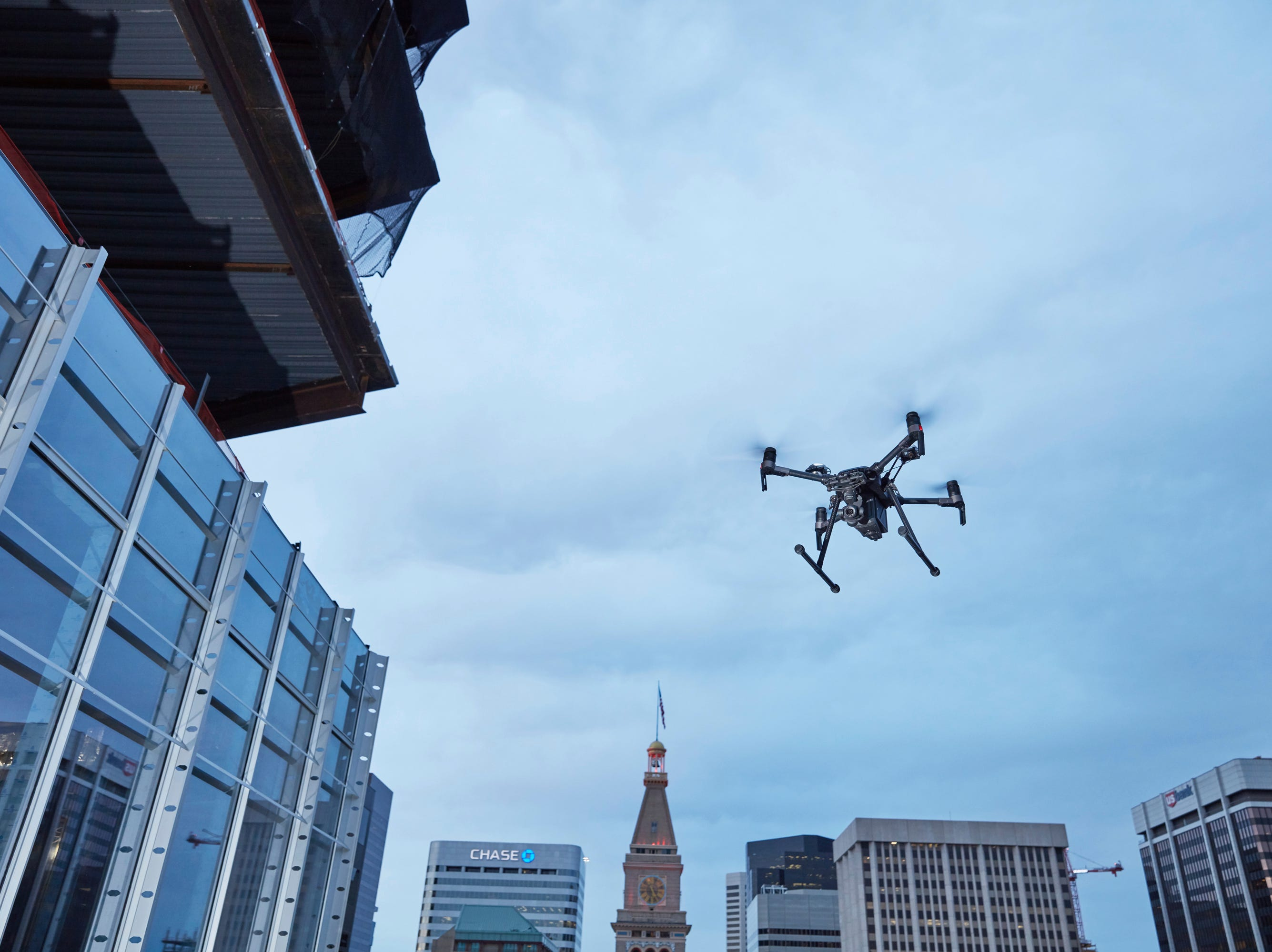 This February 2017 photo provided by DJI Technology Inc. shows a test of a type of drone in downtown Denver, that the New York Police Department can use to reduce risk to officers and bystanders during a response to dangerous situations.
