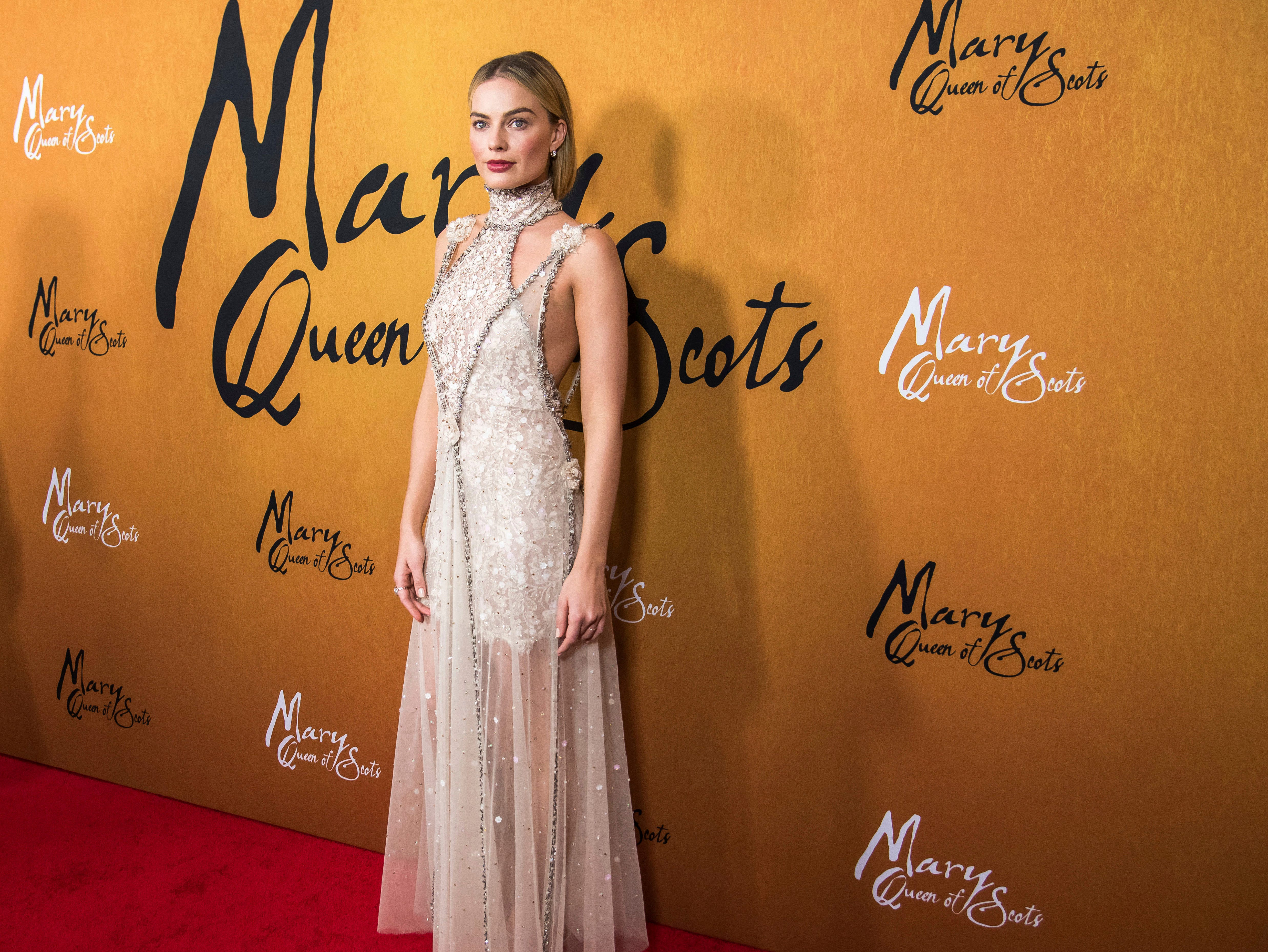 """Margot Robbie attends the premiere of """"Mary Queen of Scots"""" at The Paris Theatre on Tuesday, Dec. 4, 2018, in New York. (Photo by Charles Sykes/Invision/AP) ORG XMIT: NYCS205"""