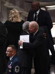 Former Vice President Joe Biden, right, arrives for the funeral service for former President George H.W. Bush at the National Cathedral in Washington, Dec. 5, 2018.