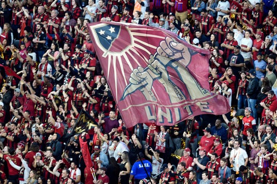 Atlanta United fans wave flags prior to the first leg of the MLS Eastern Conference Championship against the New York Red Bulls at Mercedes-Benz Stadium on Nov. 25.