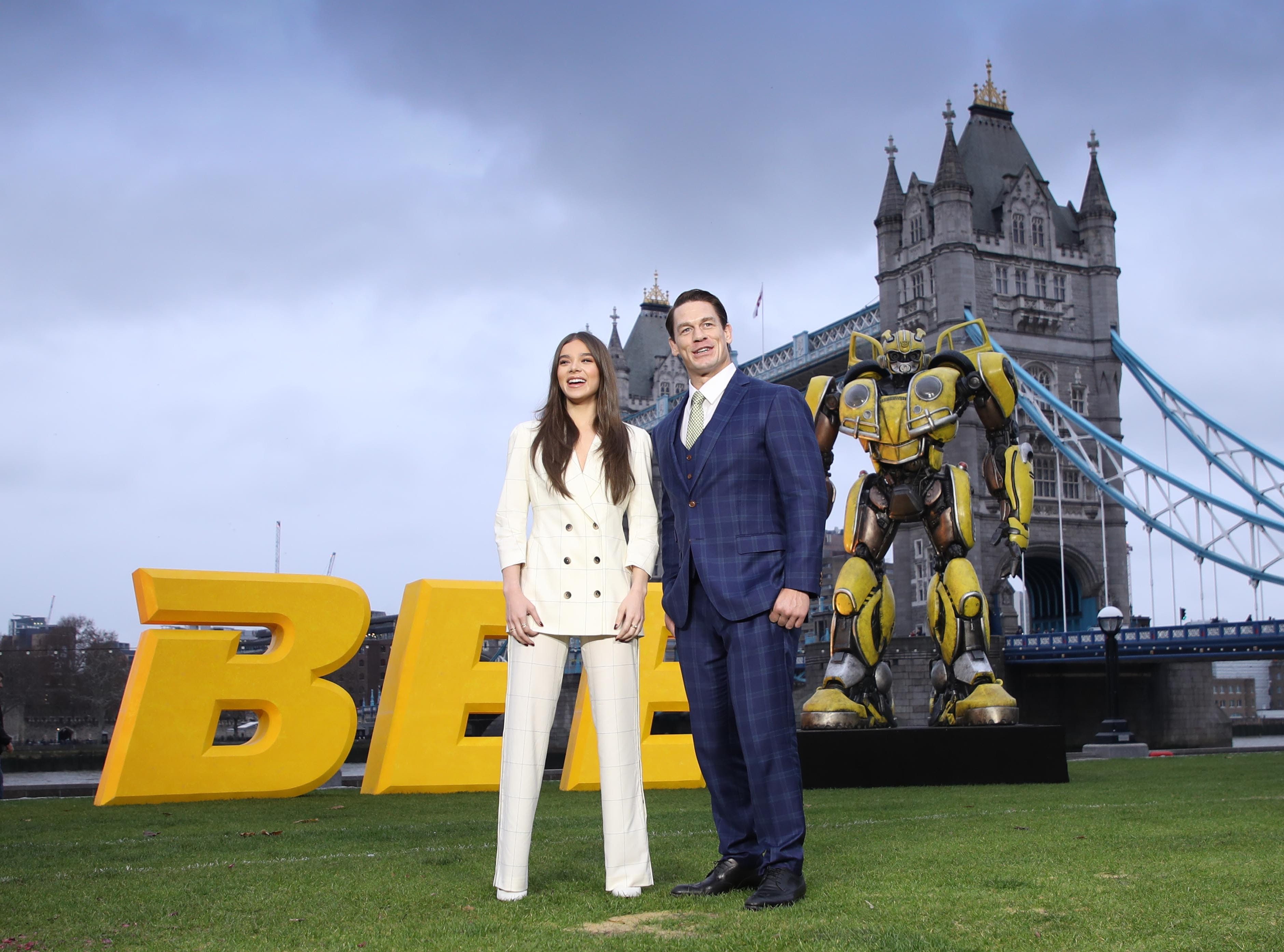 """LONDON, ENGLAND - DECEMBER 05: Hailee Steinfeld and John Cena attends a photocall for """"Bumblebee"""" at Potters Field Park on December 05, 2018 in London, England. (Photo by Mike Marsland/Mike Marsland/WireImage) ORG XMIT: 775266917 ORIG FILE ID: 1077671672"""