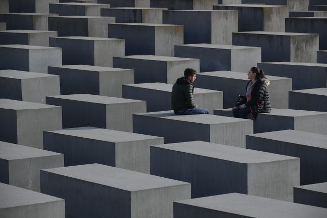 A British lingerie model is facing heavy criticism after she snapped a selfie at a Berlin Holocaust memorial, and has continued to defend her actions on social media.