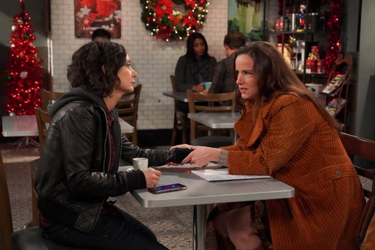 Darlene (Sara Gilbert), left, gets good  relationship advice from an unlikely source, her ex-husband's girlfriend (Juliette Lewis), in Tuesday's episode of ABC's 'The Conners.'
