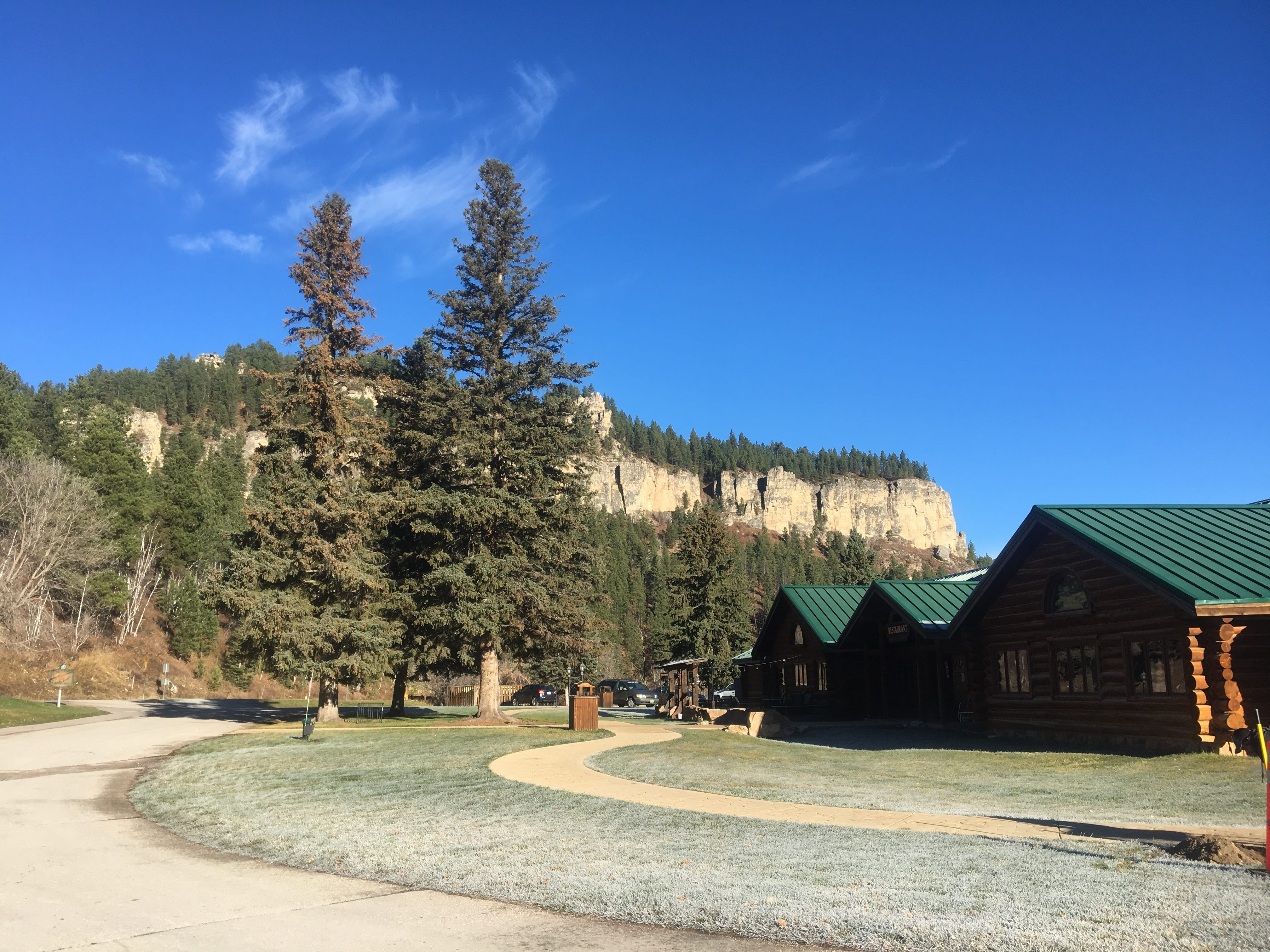 Log cabin-themed lodges within Black Hills National Forest.
