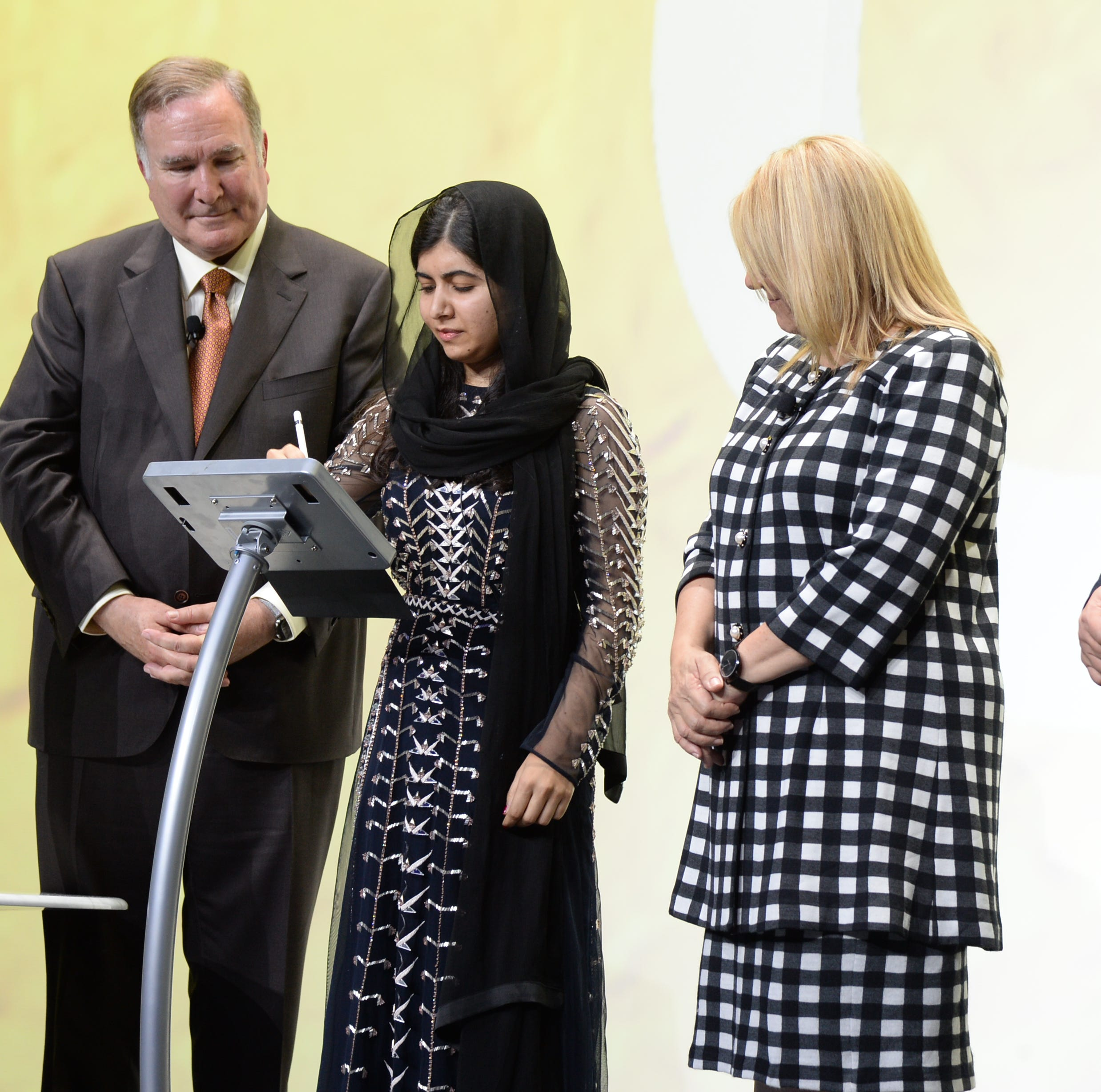 Royal Caribbean Cruises chairman and CEO Richard Fain (left), Celebrity Edge godmother Malala Yousafzai, Celebrity Cruises CEO Lisa Lutoff-Perlo and Celebrity Edge captain Costas Nestoroudis on stage during the naming ceremony for Celebrity Edge on Dec. 4, 2018.