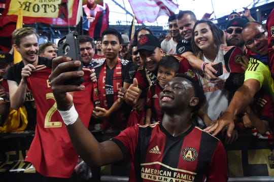 Atlanta United defender George Bello takes a selfie with fans at Mercedes-Benz Stadium on Oct. 6.