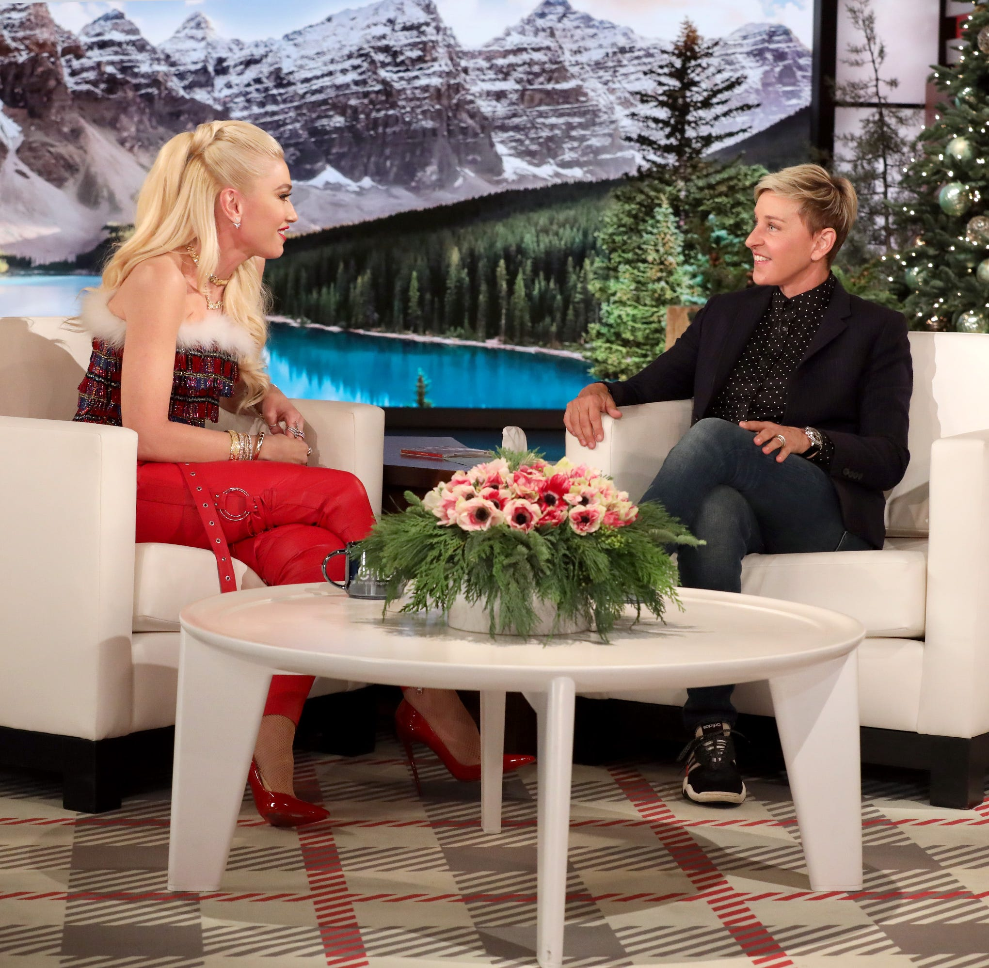 """In this photo released by Warner Bros., talk show host Ellen DeGeneres is seen during a taping of """"The Ellen DeGeneres Show"""" at the Warner Bros. lot in Burbank, Calif."""