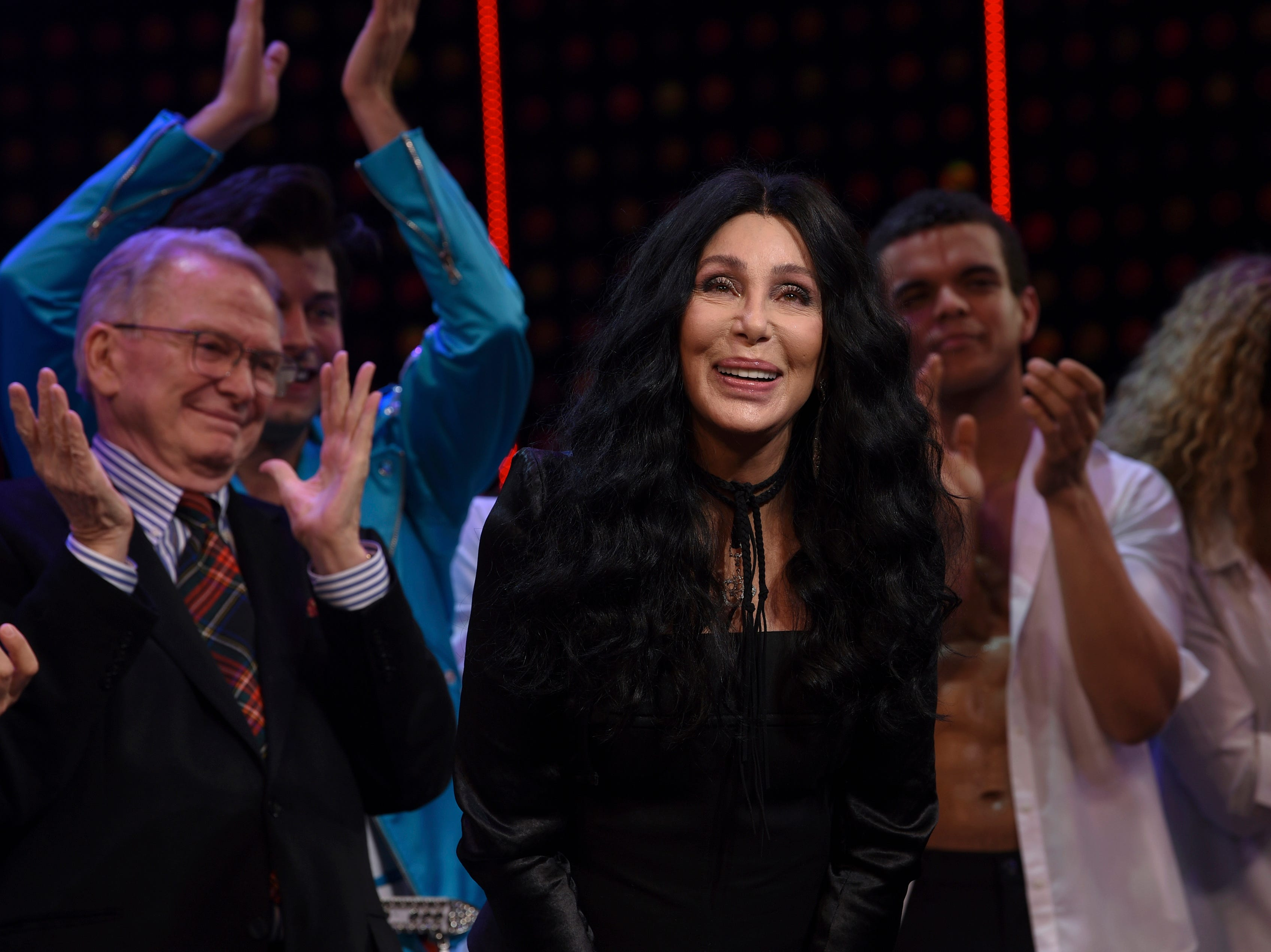 """Cher takes a bow on stage with designer Bob Mackie behind her during the curtain call for """"The Cher Show"""" Broadway musical opening night at the Neil Simon Theatre on Monday, Dec. 3, 2018, in New York. (Photo by Evan Agostini/Invision/AP) ORG XMIT: NYEA206"""