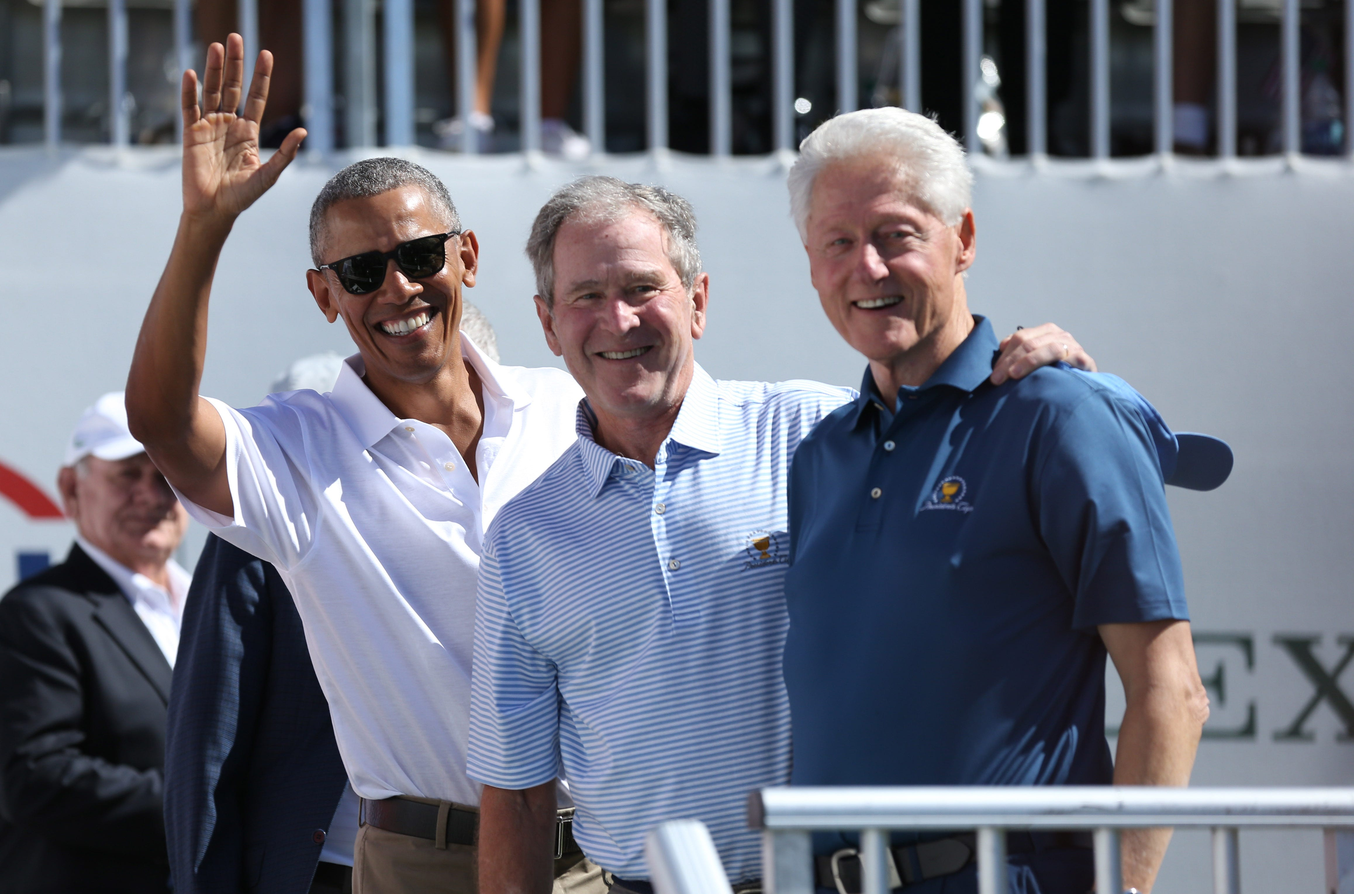 Former U.S. Presidents, from left, Barack Obama and George W. Bush and Bill Clinton smile during the first round foursomes match of The President's Cup golf tournament at Liberty National Golf Course, Sept. 28, 2017, in Jersey City, N.J.