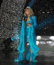 "Jennifer Aniston rocked an outrageous, Dolly Parton-inspired dress in ""Dumplin'."""