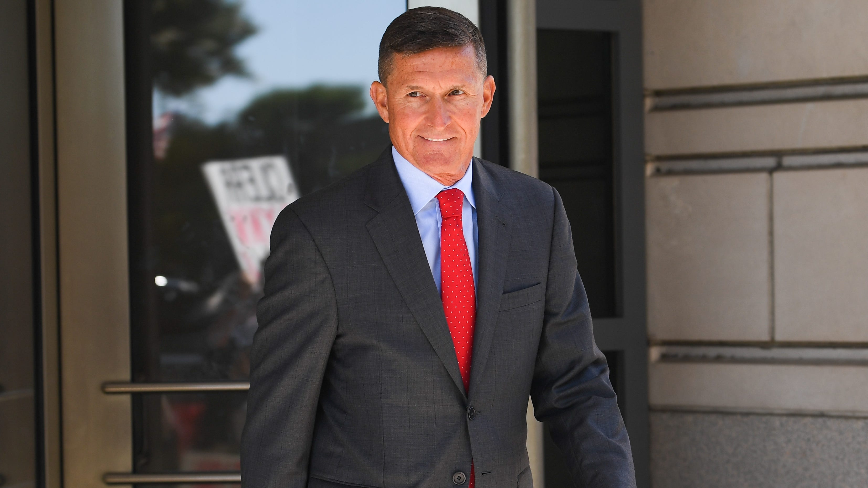 Former national security adviser Michael Flynn departs following court appearance at U.S. District Court for the District of Columbia.