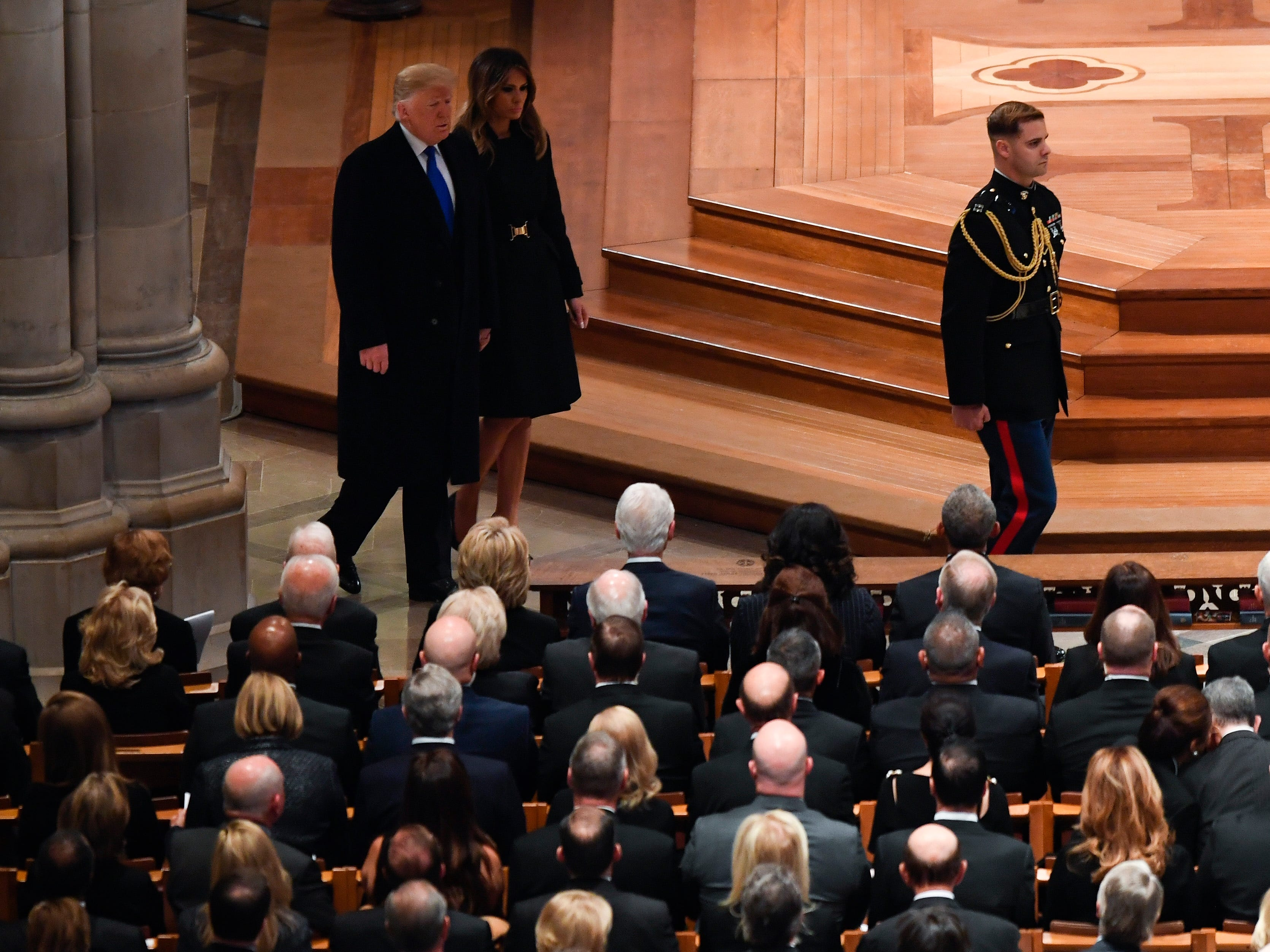 President Donald Trump and first lady Melania Trump arrive at a State Funeral for Former President George H.W. Bush at the Washington National Cathedral in Washington, Dec. 5, 2018.