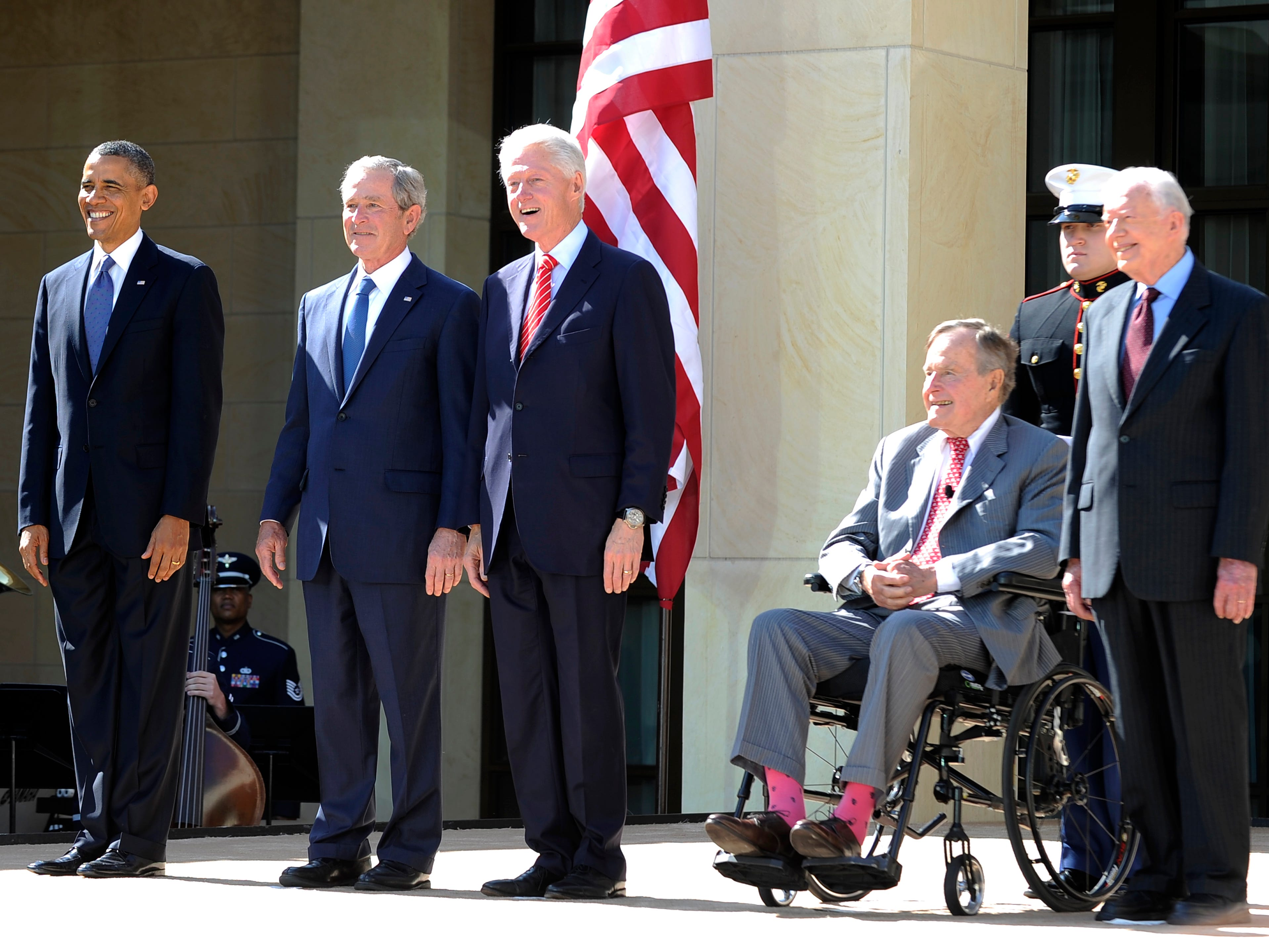 President Barack Obama, left, and former presidents George W. Bush, Bill Clinton, George H.W. Bush and Jimmy Carter arrive on stage for the George W. Bush Presidential Center dedication ceremony in Dallas, Texas, on April 25, 2013.