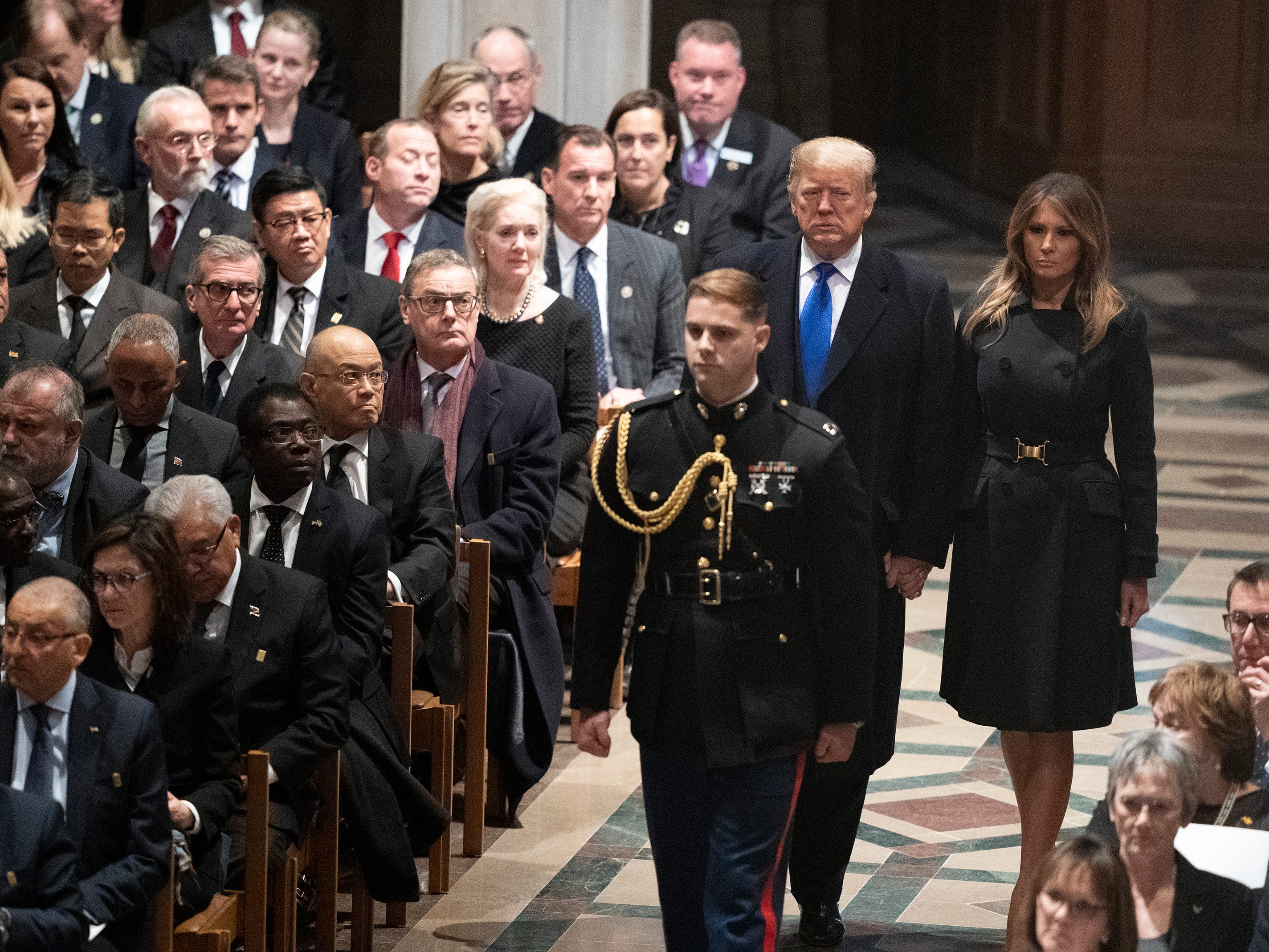 President Donald Trump and first lady Melania Trump arrive for the State Funeral for former President George H.W. Bush at the Washington National Cathedral in Washington, Wednesday, Dec. 5, 2018.