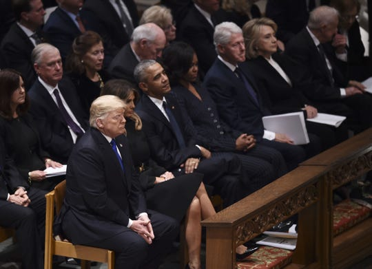 (Front L-R)US President Donald Trump, First Lady Melania Trump, former US President Barack Obama, former US First Lady Michelle Obama, former US President Bill Clinton, former First Lady Hillary Clinton, and former US President Jimmy Carter sit before the funeral service for former US President George H. W. Bush at the National Cathedral in Washington, DC on December 5, 2018. (Photo by Brendan SMIALOWSKI / AFP)BRENDAN SMIALOWSKI/AFP/Getty Images ORIG FILE ID: AFP_1BD270