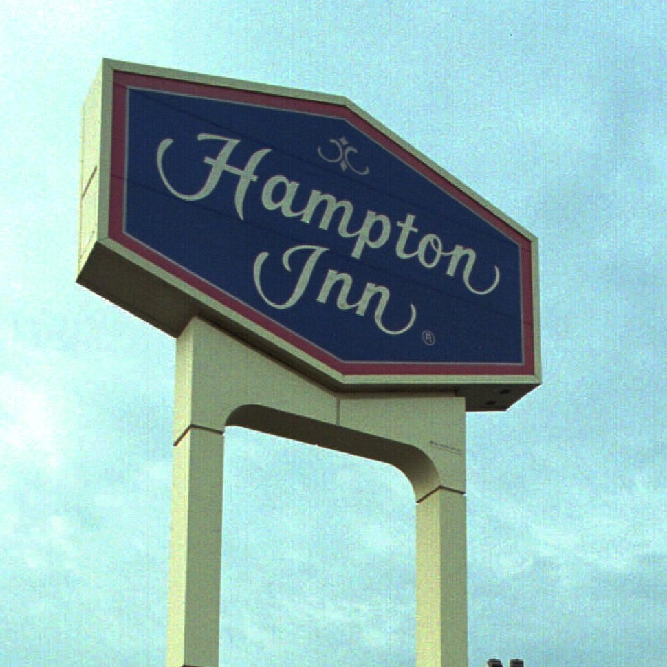 A woman who stayed at the Hampton Inn and Suites in Albany, New York, in 2015 has sued its parent company, Hilton Worldwide, saying an employee there filmed her in the shower and used her personal information to blackmail her.