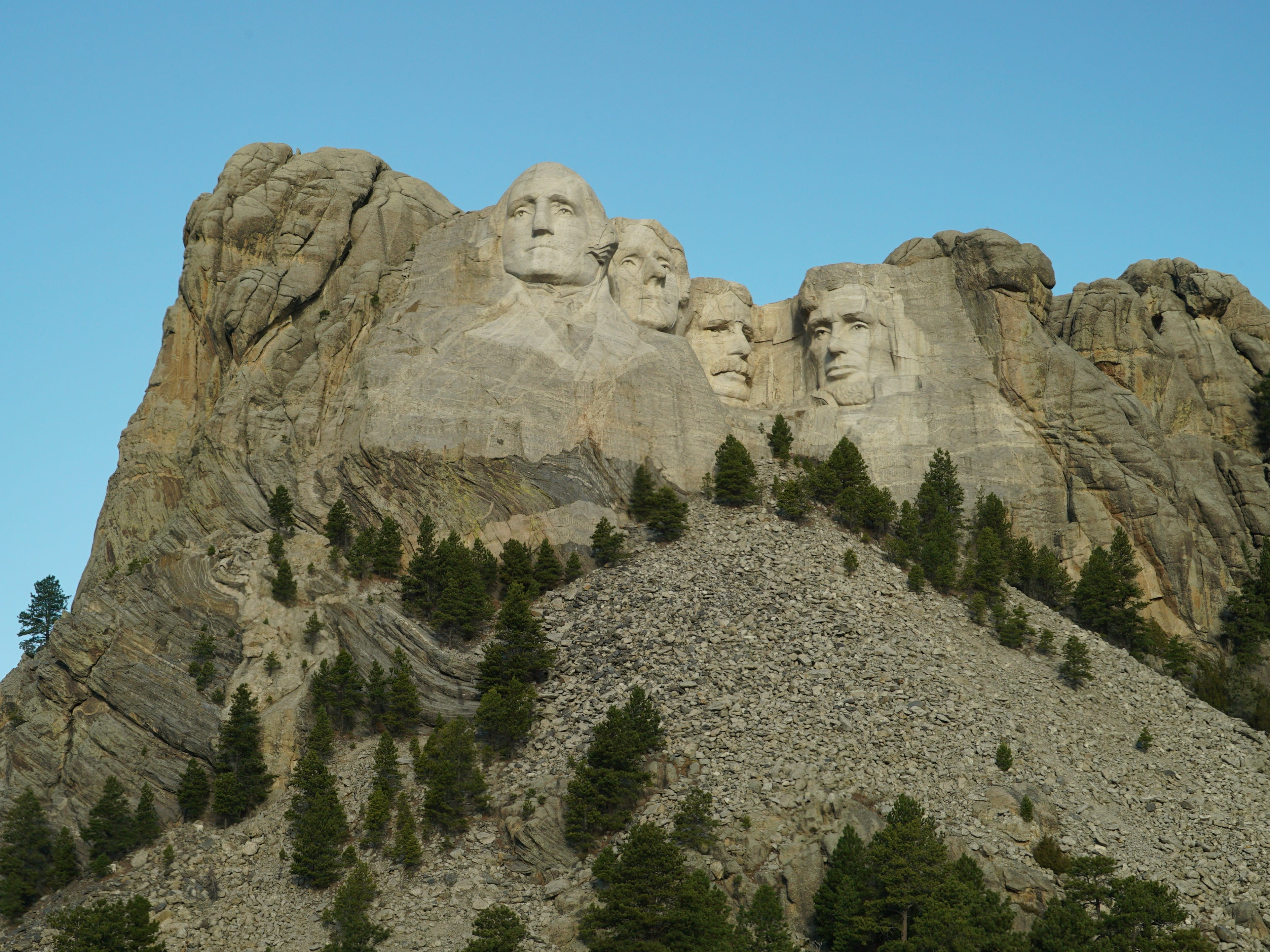 The 450,000 tons of rock blown or chiseled off the mountain still lies below Mount Rushmore.