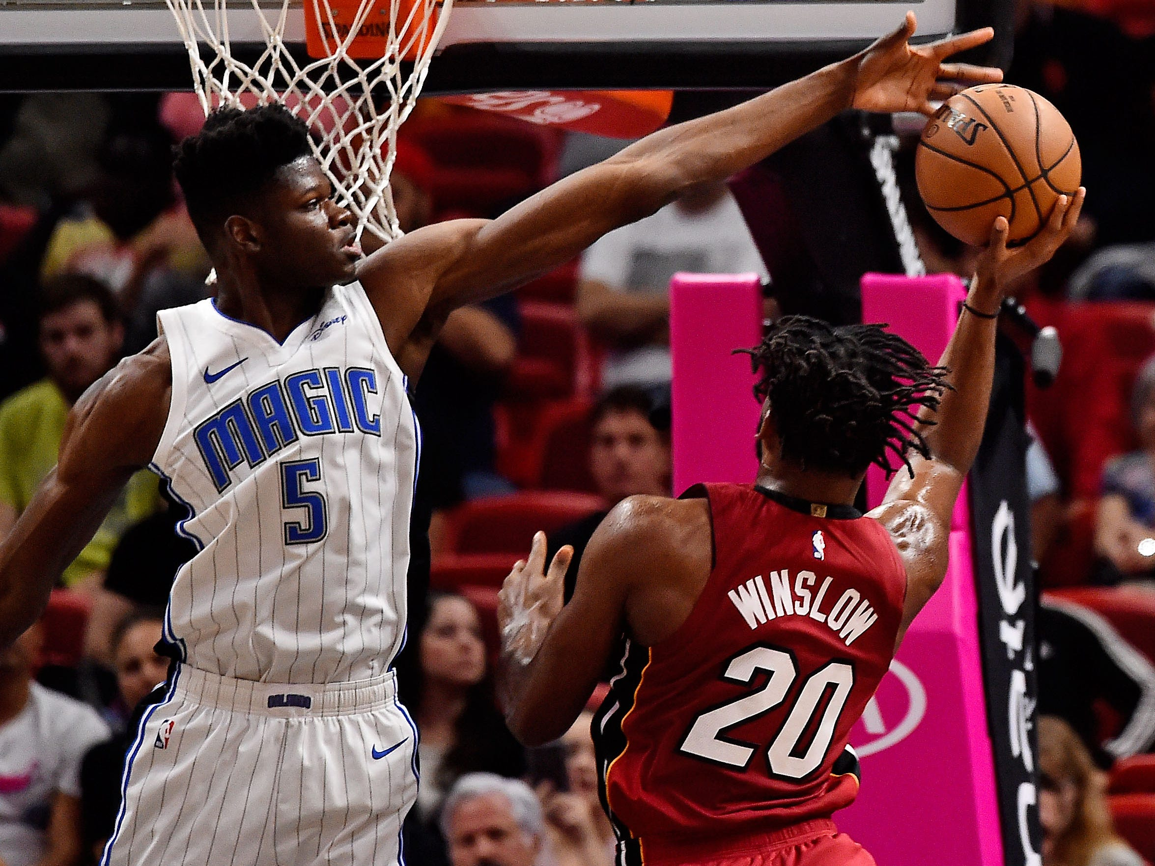 Dec. 4: Magic center Mo Bamba blocks a shot attempt by Heat forward Justise Winslow during the first half in Miami.