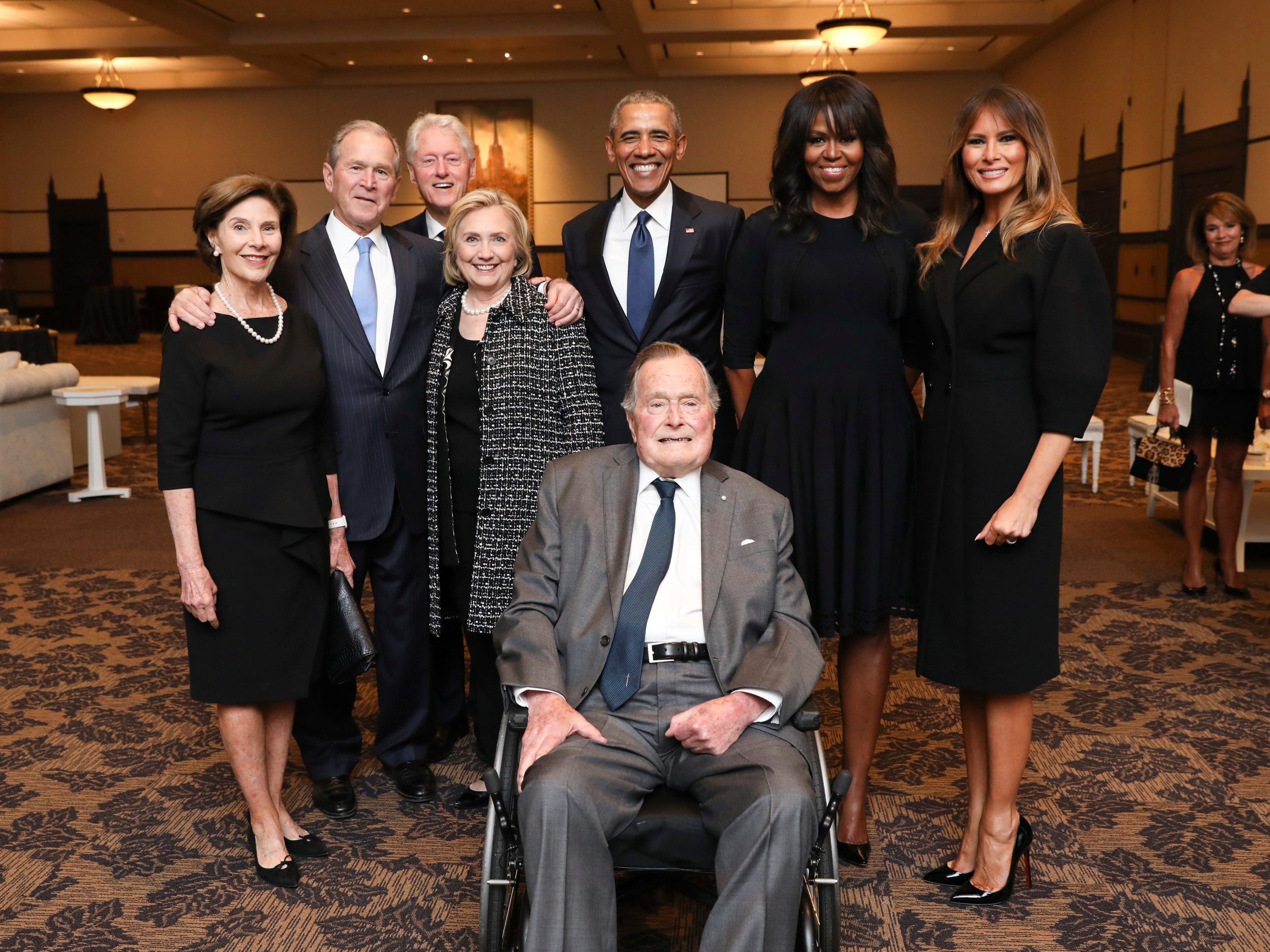 This Saturday, April 21, 2018, photo provided by the Office of former U.S. President George H.W. Bush, shows Bush, front, and past presidents and first ladies Laura Bush, from left, George W. Bush, Bill Clinton, Hillary Clinton, Barack Obama, Michelle Obama and current first lady Melania Trump, in a group photo at the funeral service for former first lady Barbara Bush, in Houston.