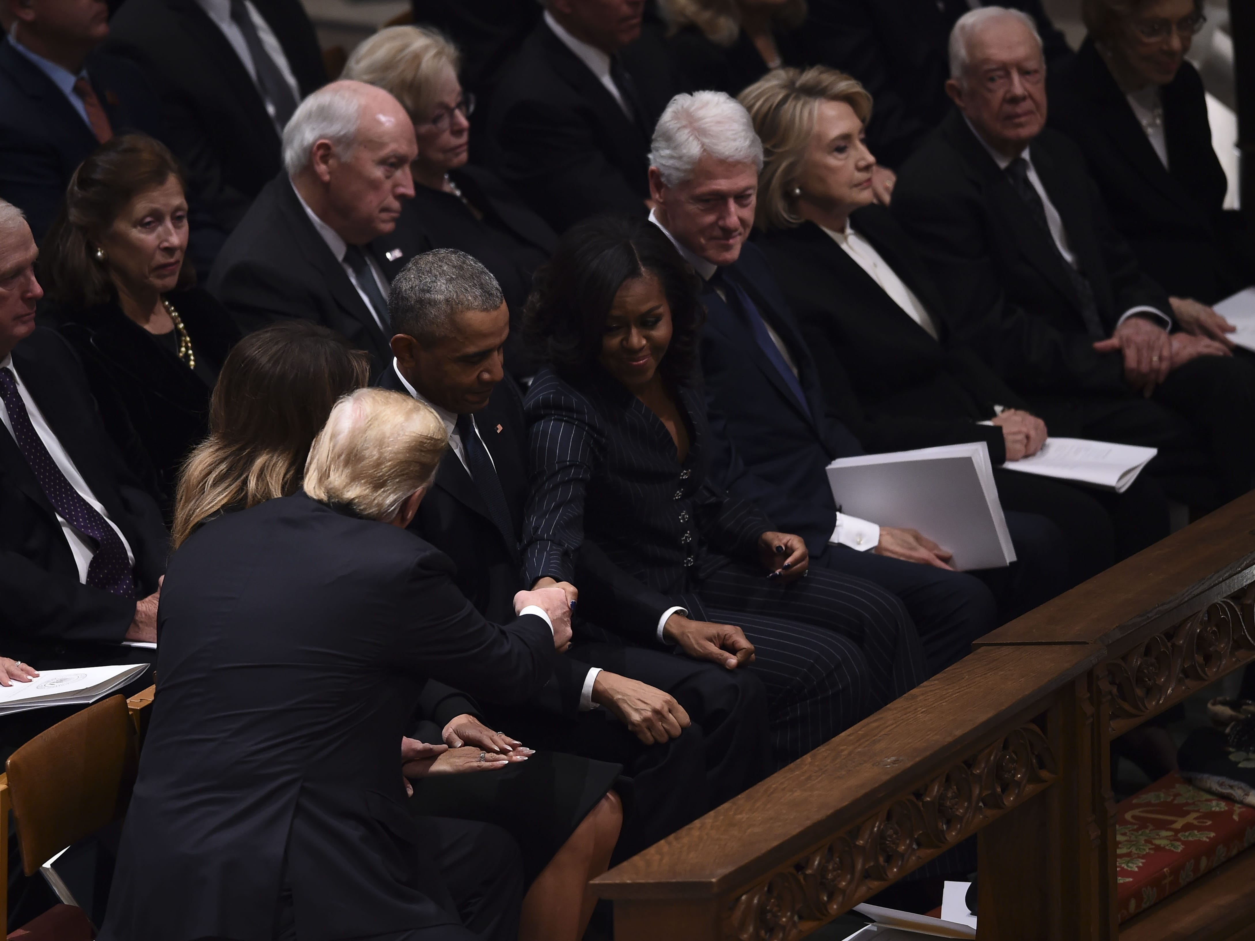 Silence, straight-ahead stares and candy mark rare full meeting of presidents' club at Bush funeral