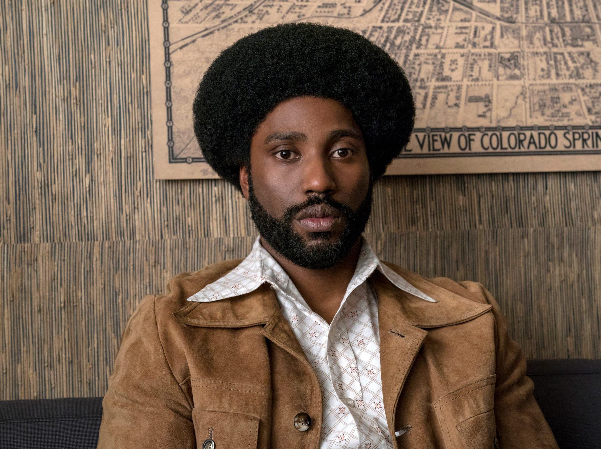 "This image released by Focus Features shows John David Washington in a scene from ""BlacKkKlansman."" The film is among the American Film Institute's top 10 films of the year. AFI announced its selections for the 19th AFI Awards Tuesday, Dec. 4, 2018, recognizing works deemed culturally and artistically significant by a jury of AFI Trustees, scholars and critics."