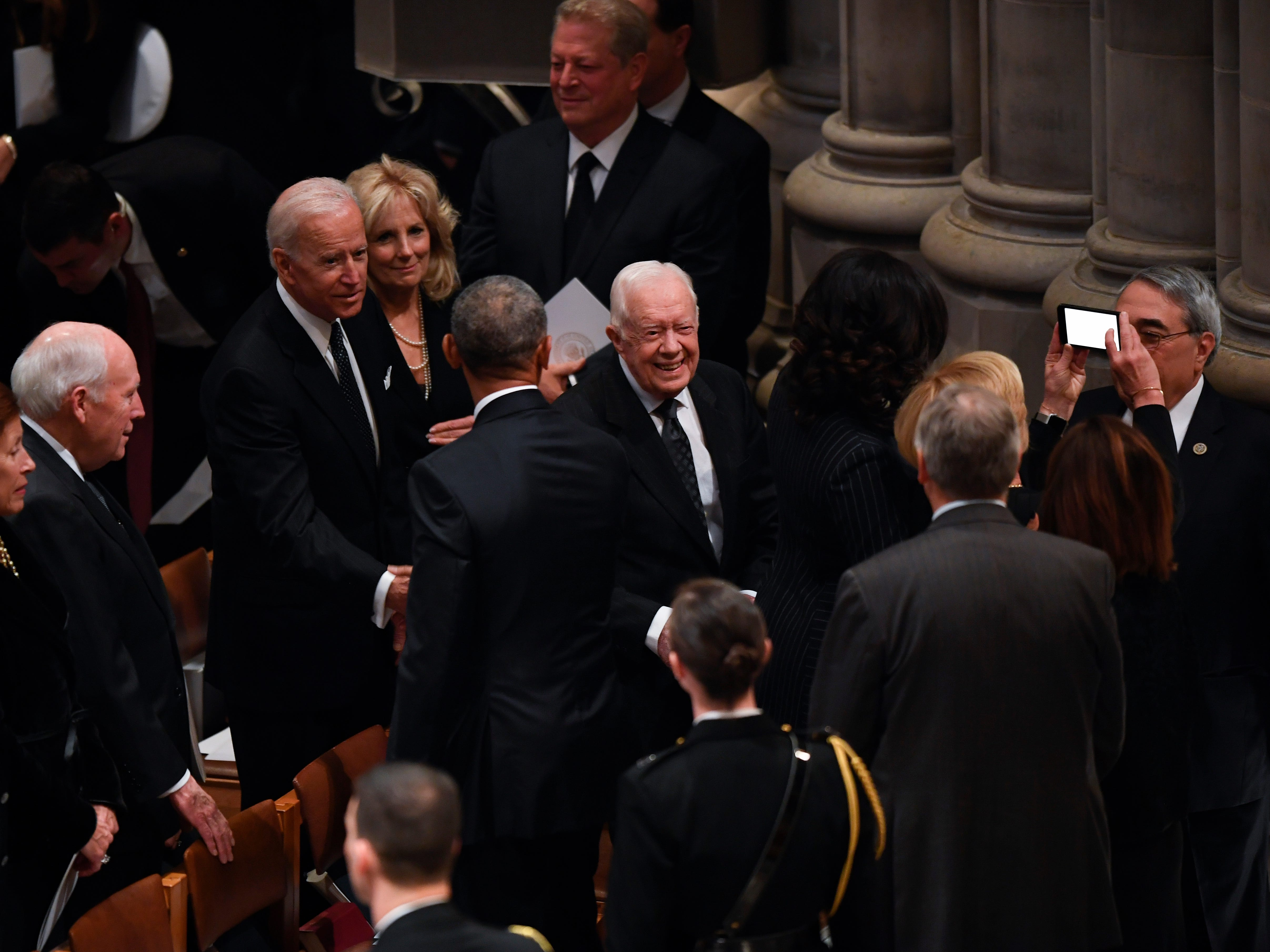 Former President Jimmy Carter and former Vice President Joe Biden arrive at a state funeral for former President George H.W. Bush at the Washington National Cathedral, in Washington, Dec. 5, 2018.