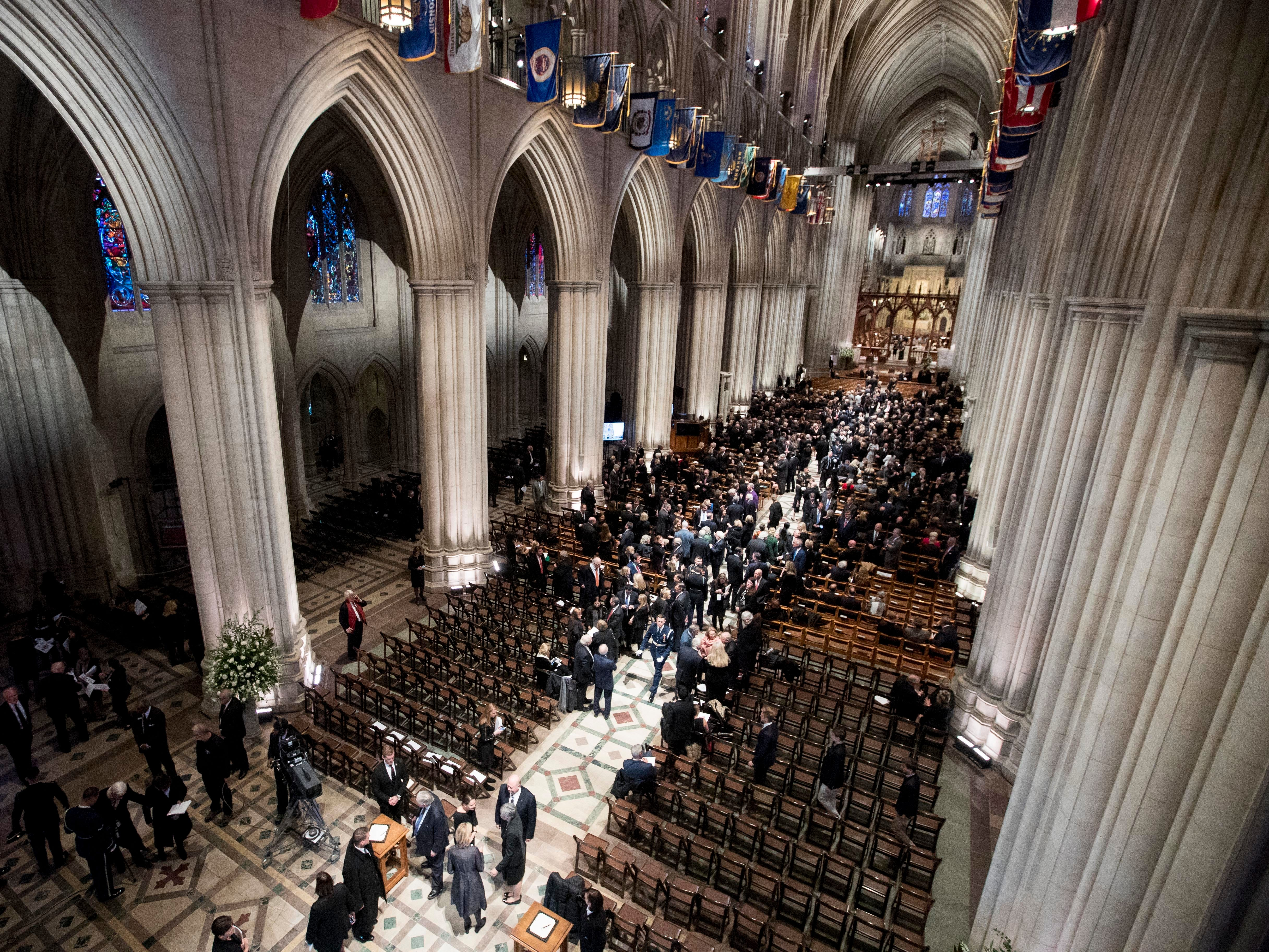 People arrive for a State Funeral for former President George H.W. Bush at the National Cathedral, Wednesday, Dec. 5, 2018, in Washington.