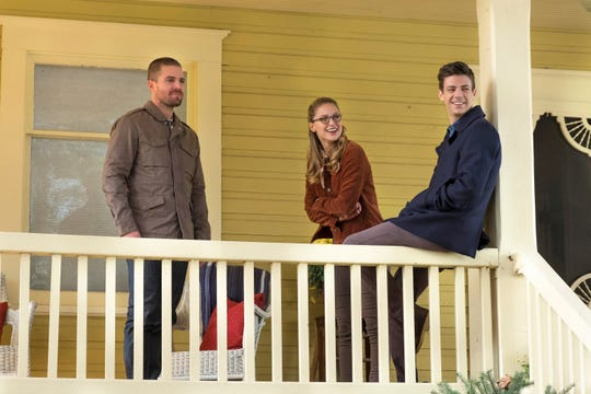 Stephen Amell (left), Melissa Benoist and Grant Gustin - the CW's main superheroes - visit Smallville for the first time in the new crossover.