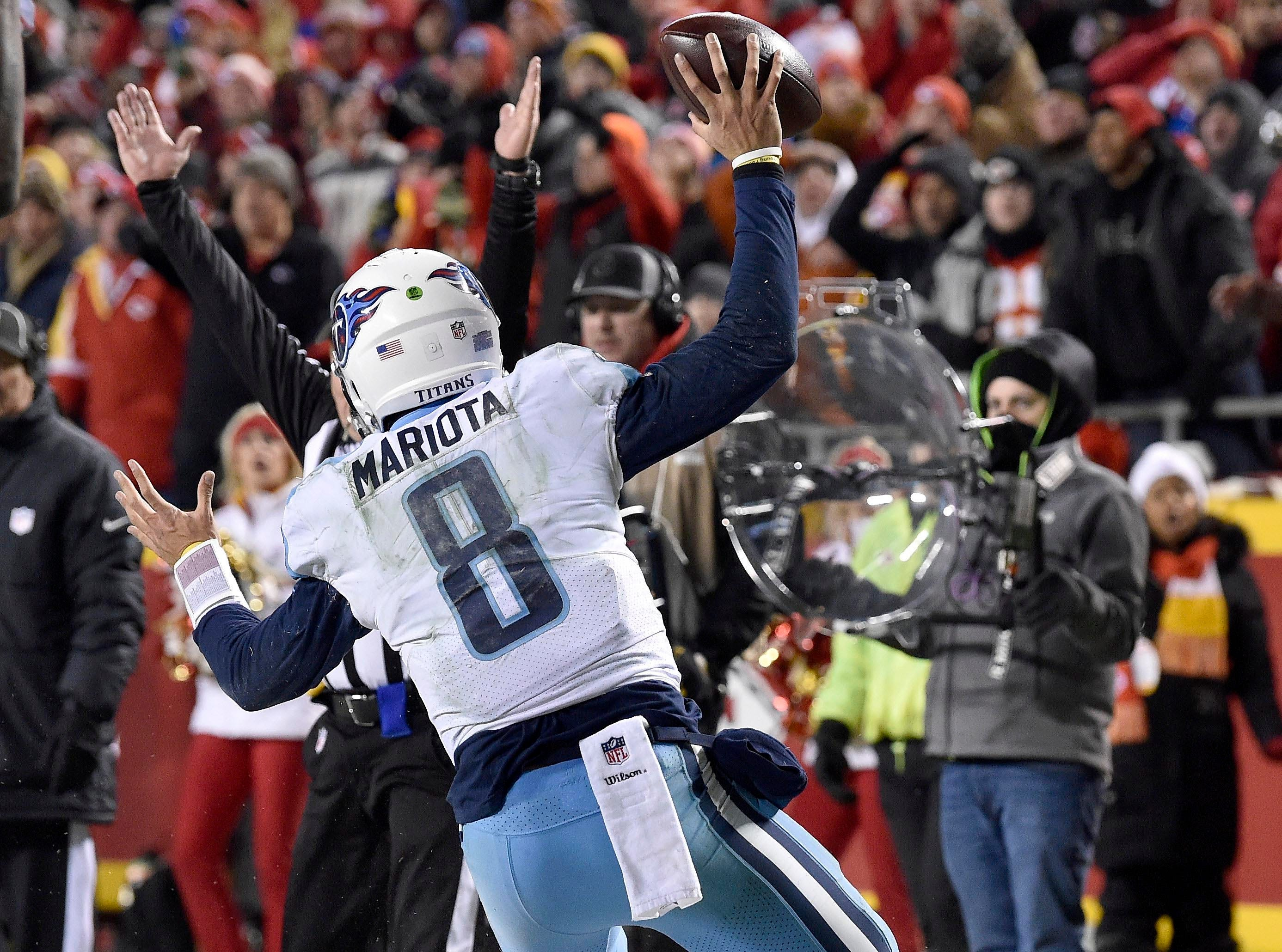 Jan. 6: Tennessee Titans quarterback Marcus Mariota celebrates after scoring a miraculous touchdown in the third quarter of the Titans' comeback win against the Kansas City Chiefs in the AFC's wild-card round at Arrowhead Stadium.