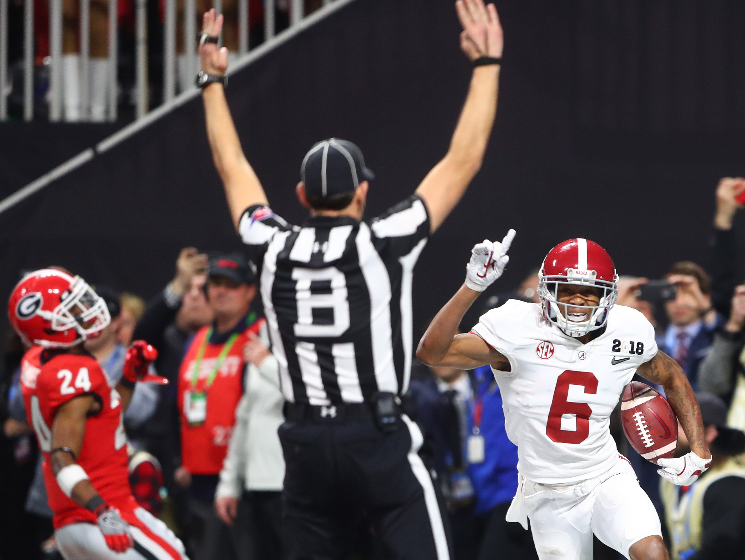 Jan. 8: Alabama Crimson Tide wide receiver DeVonta Smith (6) celebrates after catching the game-winning touchdown in overtime against the Georgia Bulldogs to win the national championship.