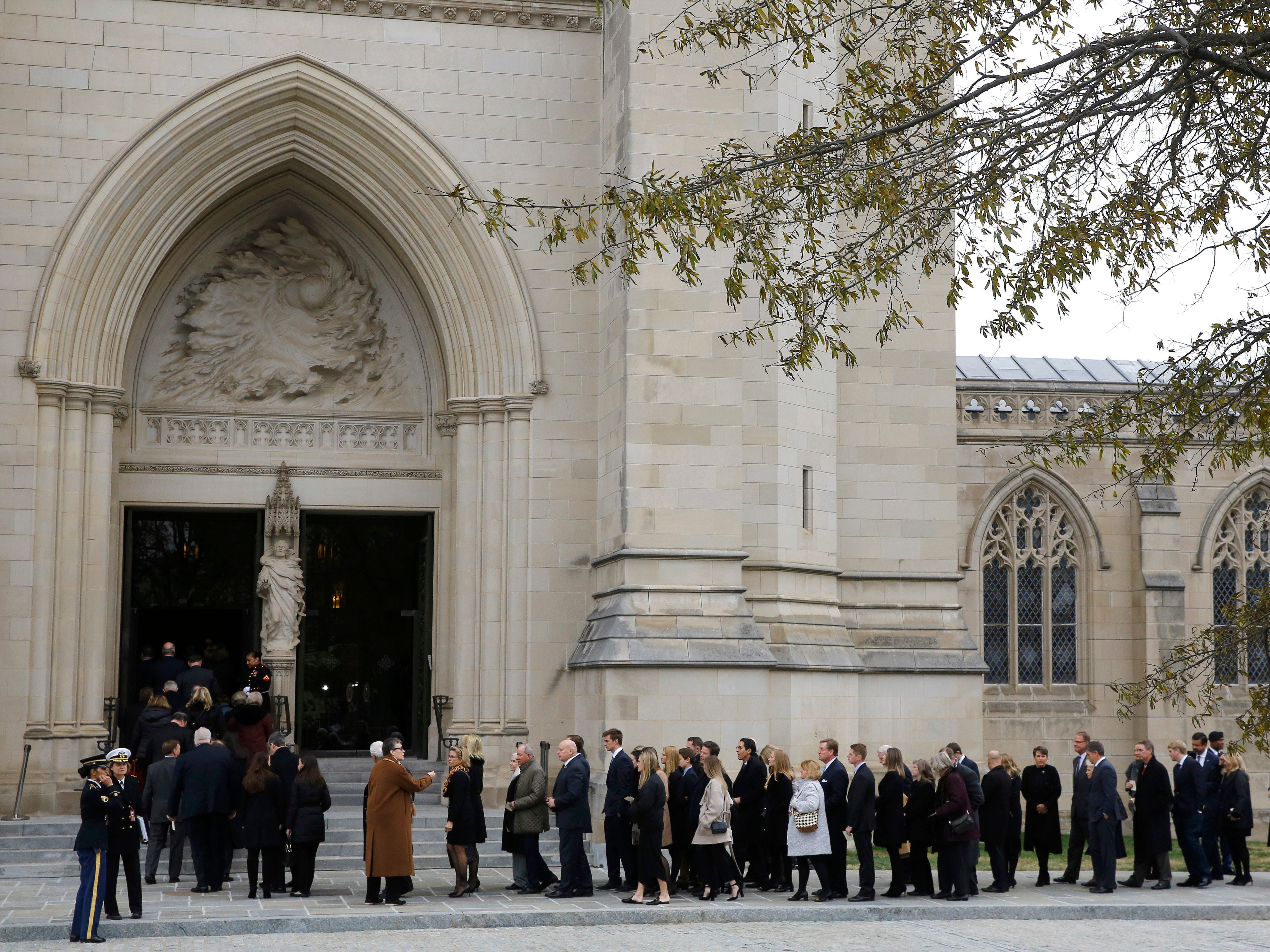 Mourners file into the Washington National Cathedral before the State Funeral for former President George H.W. Bush in Washington, Wednesday, Dec. 5, 2018.