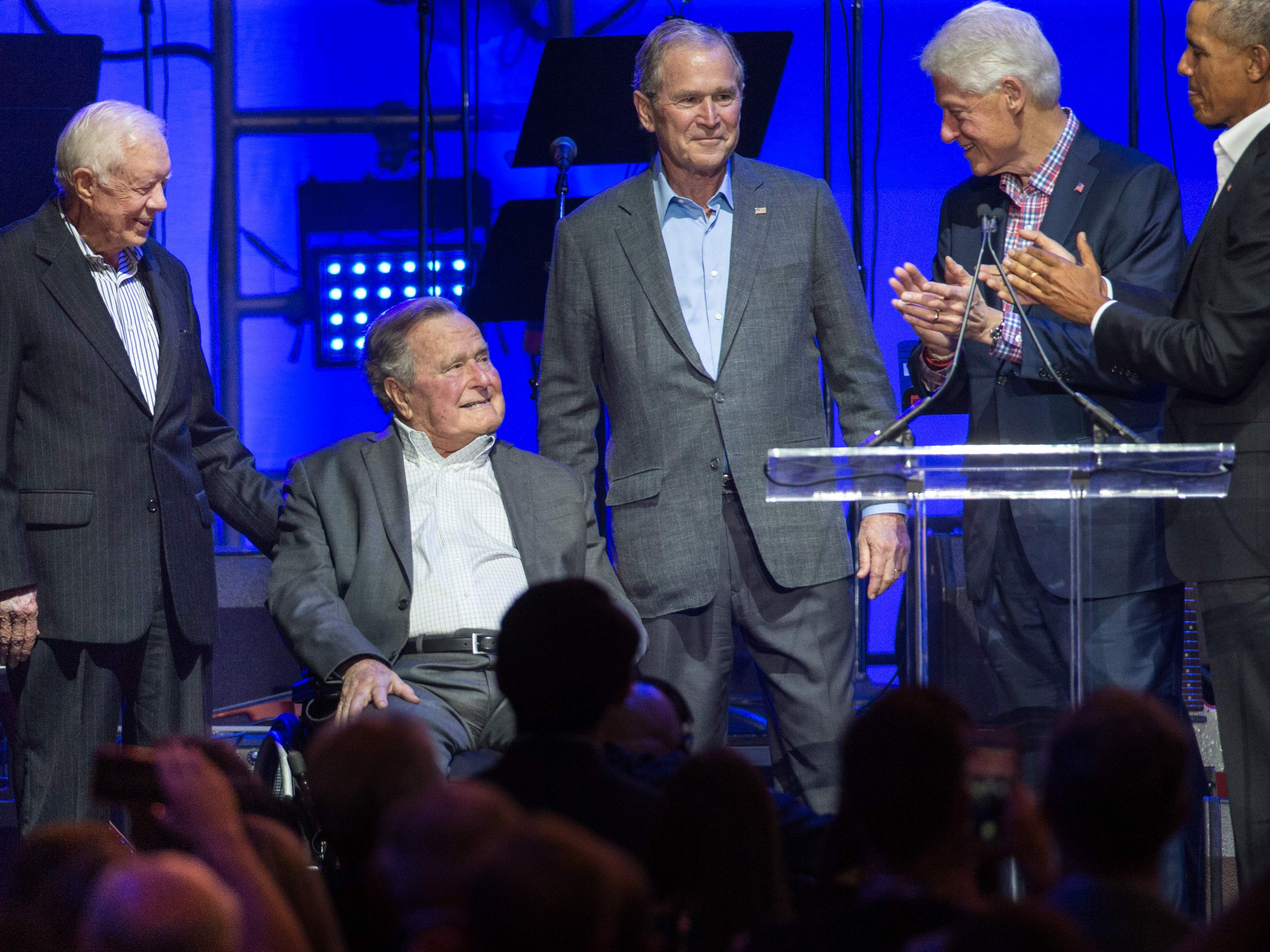 Former U.S. Presidents, from left, Jimmy Carter, George H. W. Bush, George W. Bush, Bill Clinton and Barack Obama attend the Hurricane Relief concert in College Station, Texas, Oct. 21, 2017.