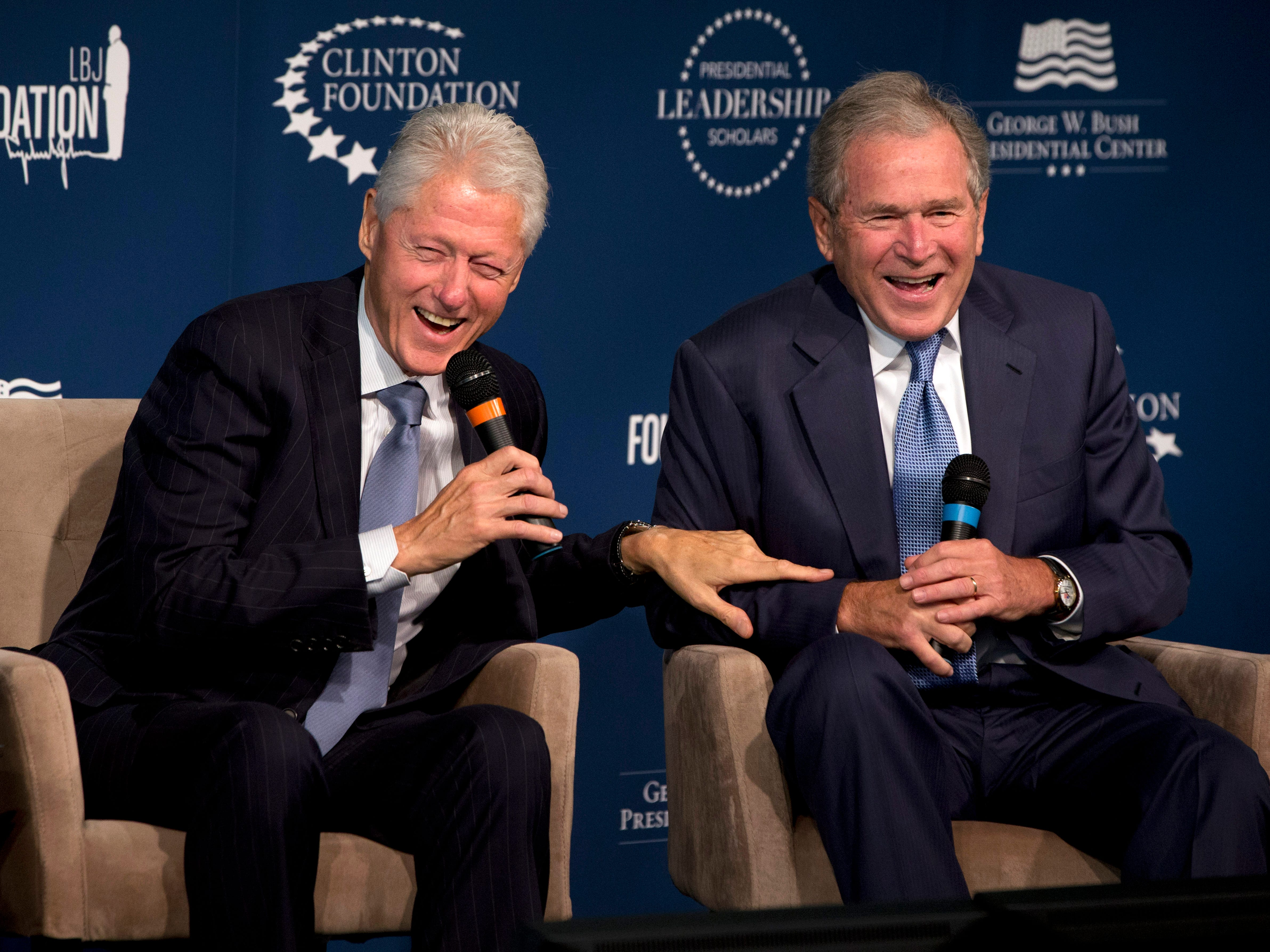 Former Presidents Bill Clinton, left, and George W. Bush, laugh while participating in the Presidential Leadership Scholars Program Launch, Monday, Sept. 8, 2014, at The Newseum in Washington.