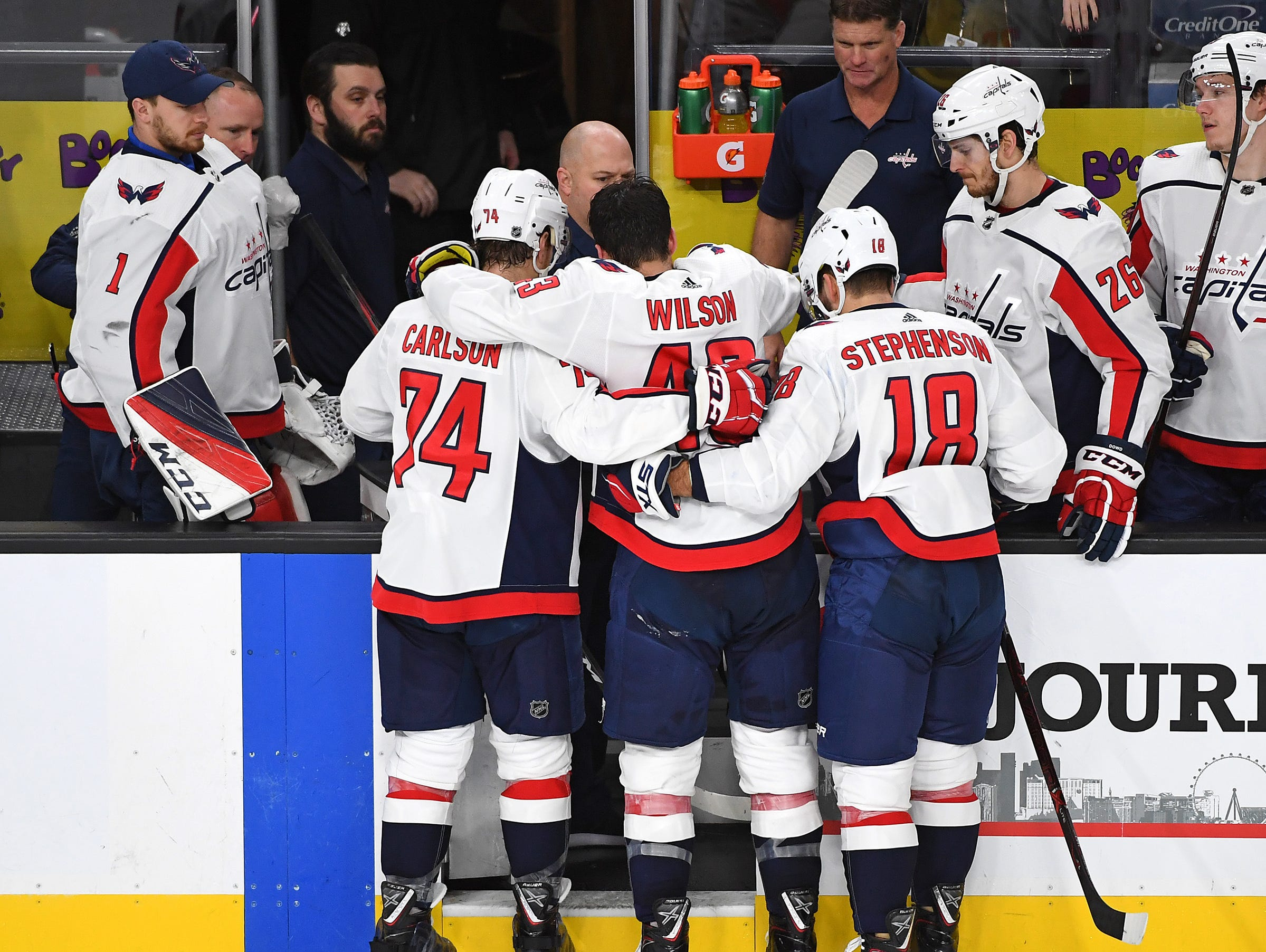 Dec. 4: Washington Capitals right wing Tom Wilson (43) is helped off the ice by defenseman John Carlson (74) and center Chandler Stephenson (18) after suffering an apparent injury during the second period against the Vegas Golden Knights at T-Mobile Arena.
