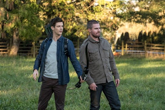 """Barry Allen (Grant Gustin, left) and Oliver Queen (Stephen Amell) swap bodies, abilities and heroic personas in Sunday's episode of CW's """"The Flash,"""" kicking off a three-night crossover."""
