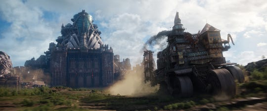 "The great predator city of London (left) hunts down moving small towns to take their resources, human and otherwise, in ""Mortal Engines."""
