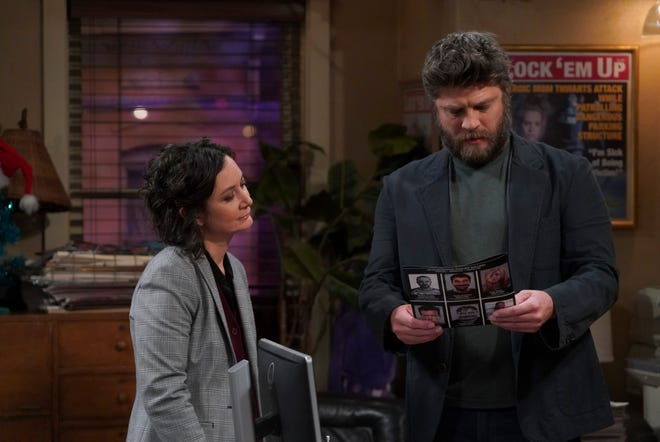 The workplace gets much trickier for colleagues Darlene (Sara Gilbert), left, and Ben (Jay R. Ferguson) in Tuesday's episode of the ABC comedy, 'The Conners.'