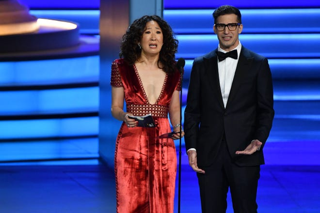 After presenting together at the Emmy Awards in September, Sandra Oh, left, and Andy Samberg are reuniting to co-host the 2019 Golden Globes.