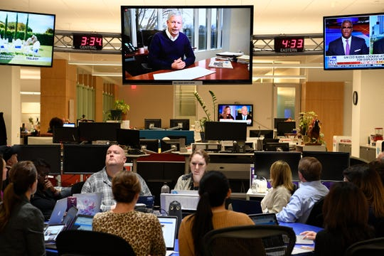 Gannett President and Chief Executive Officer Robert J. Dickey is seen on large screen as he announces his intention to retire during an employee webcast as employees watch from the hub in the USA TODAY newsroom on Dec 5, 2018.