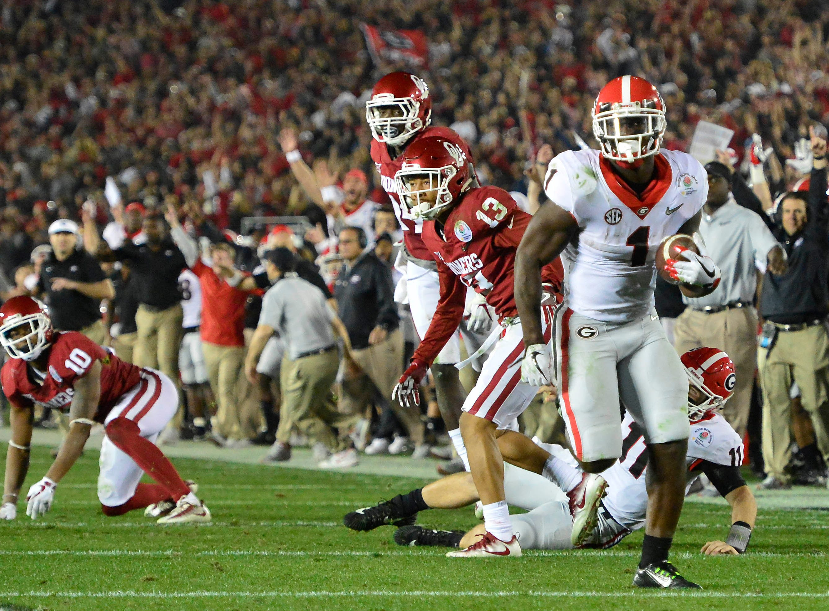 Jan. 1: Georgia Bulldogs running back Sony Michel (1) scores the winning touchdown in overtime against the Oklahoma Sooners in the Rose Bowl.
