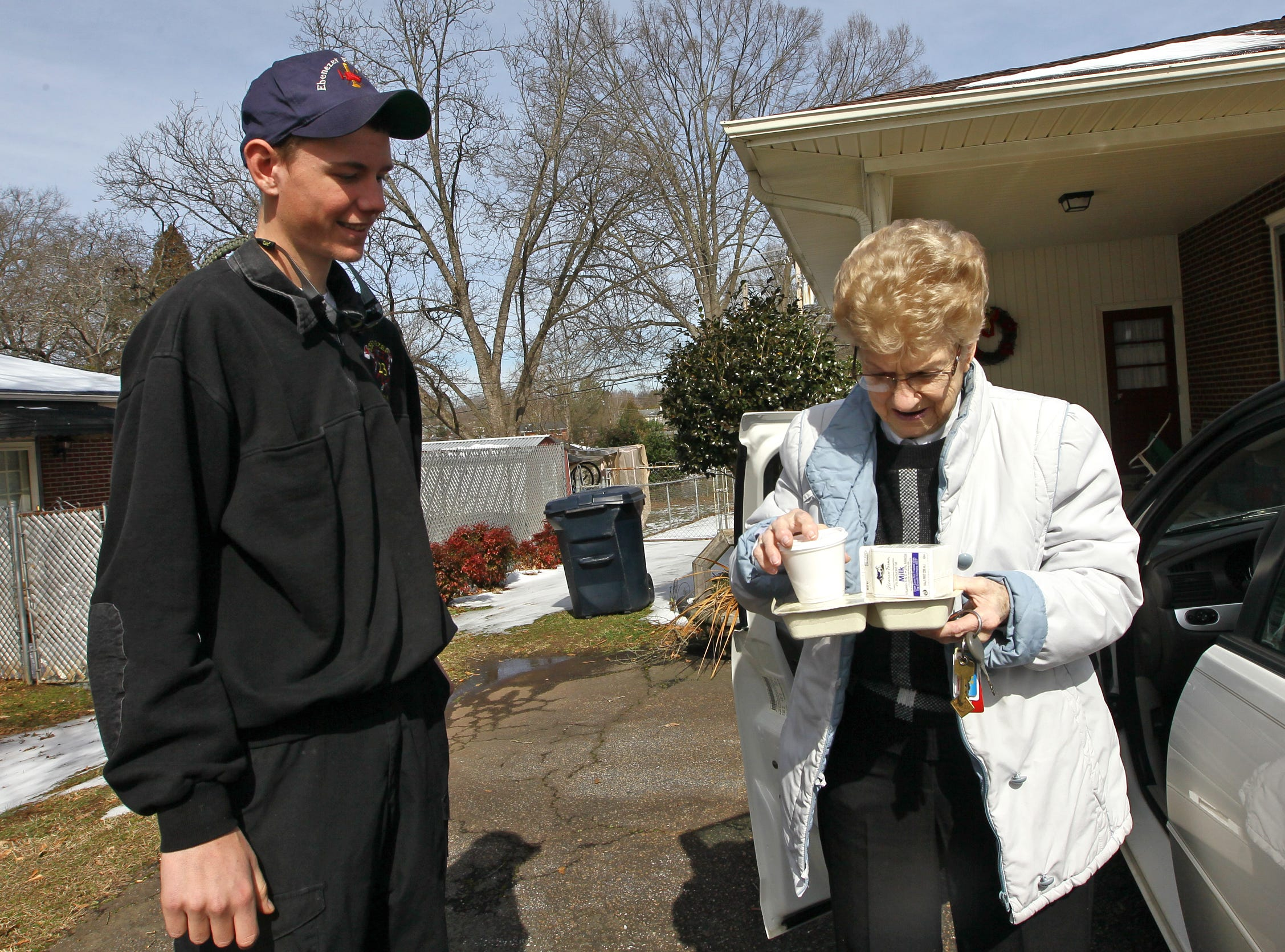 McKensey Ashley, left, of Anderson County EMS delivers a hot meal to J.W. McAlister in Anderson. Anderson County Meals on Wheels had help from Anderson County workers in delivering meals in four-wheel drive vehicles on roads with snow and ice in 2014.