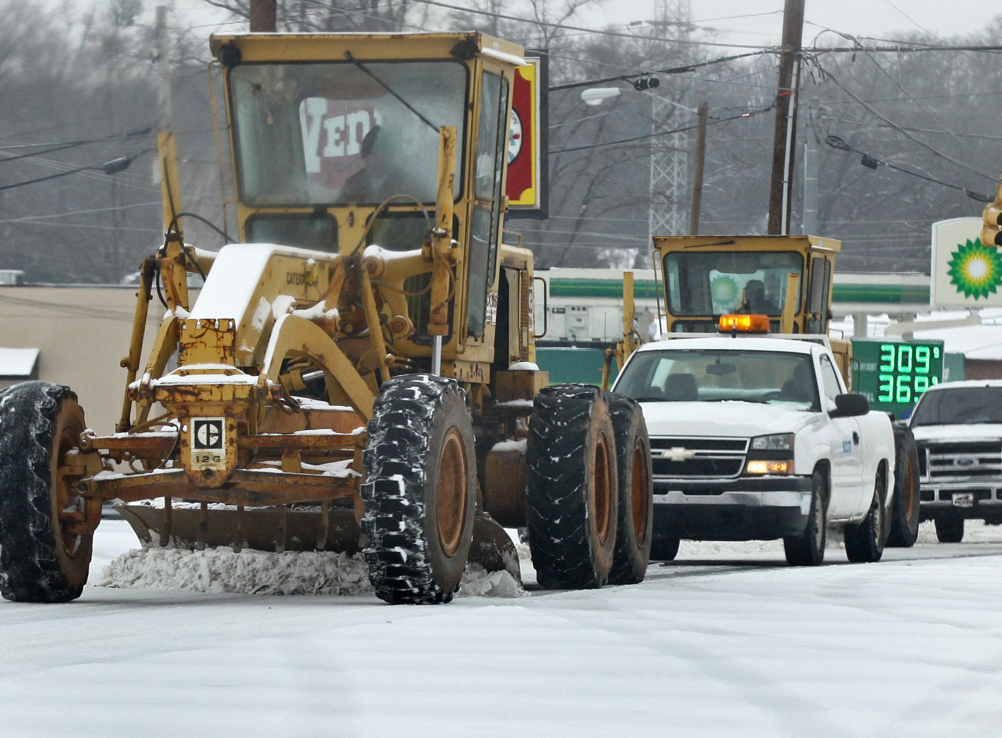 A plow moves snow along East Greenville Street near the AnMed Hospital in Andersonduring the first snow of 2014.