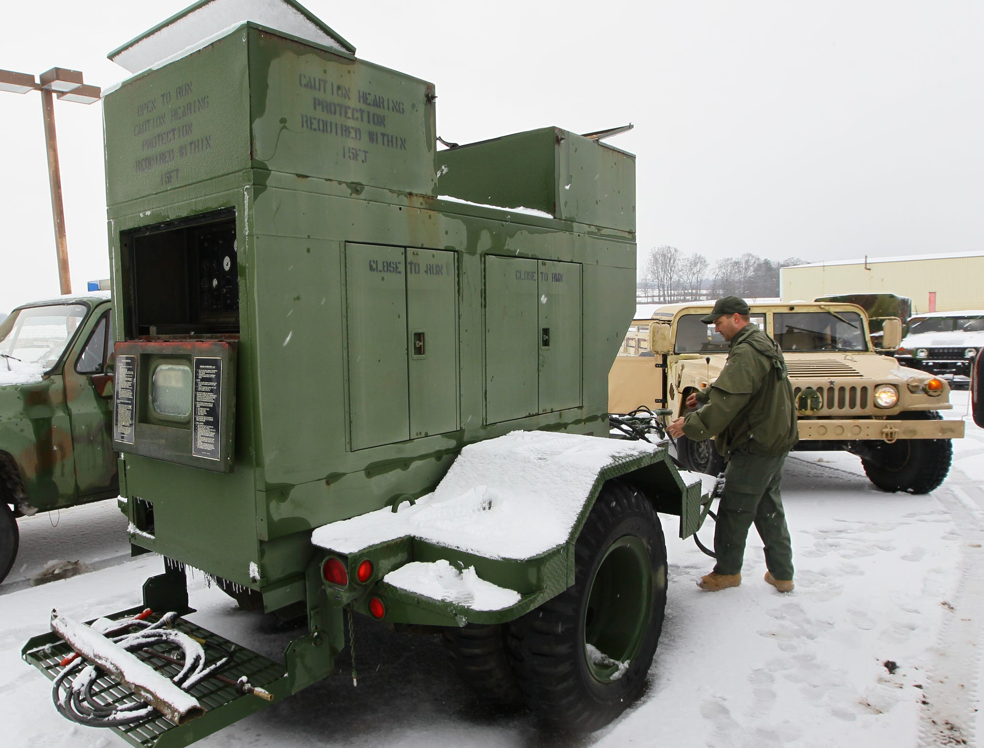 James Culbertson, a radio technician with the Anderson County Sheriff's office, tests a 30 Kilowatt generator they acquired from Fort Jackson, at their office at the Anderson Regional Airport. The generator is ready for use in a power outage, keeping a command center operationalduring the first snow of 2014.