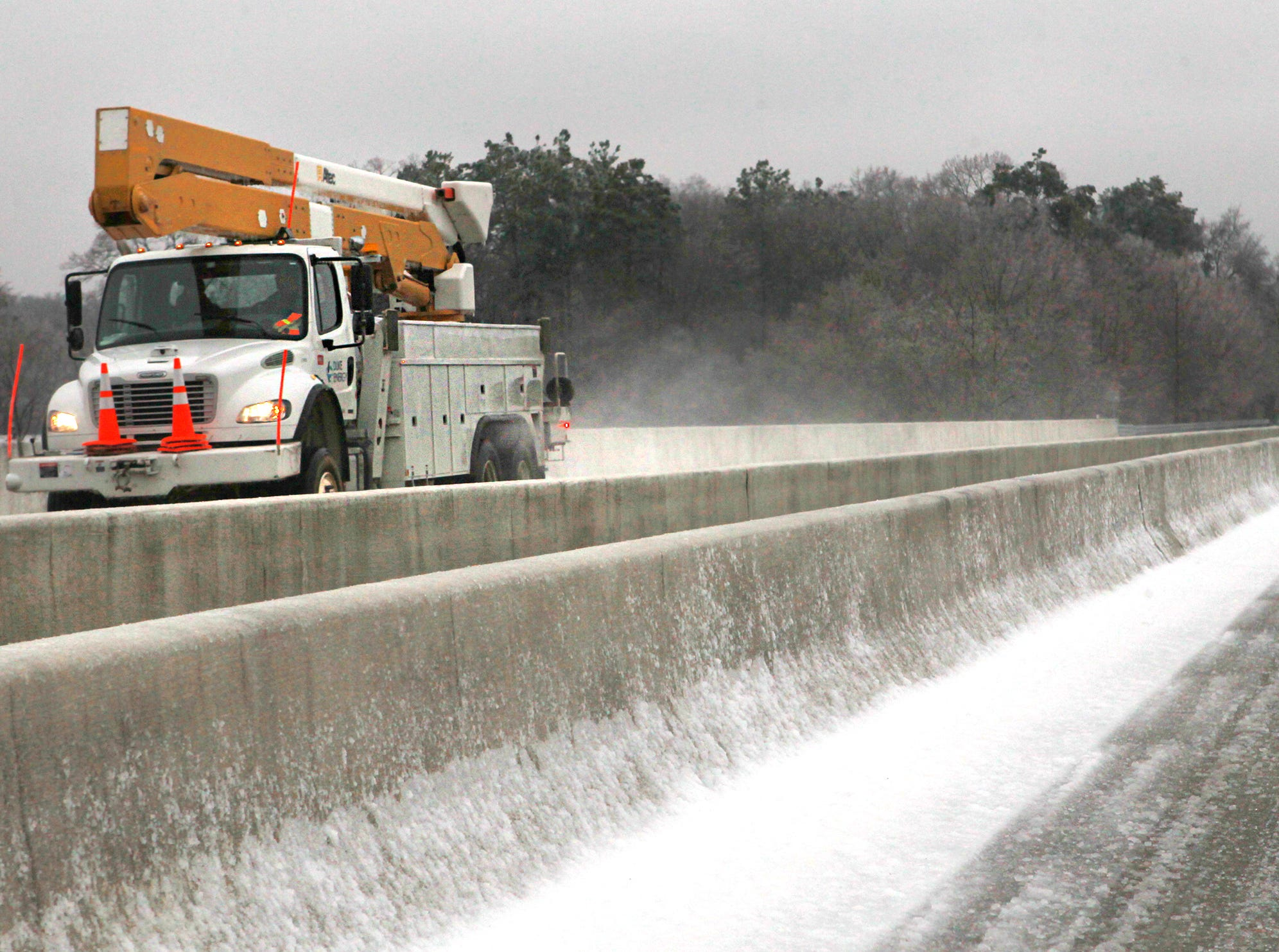 A Duke Energy truck drives over a bridge on S.C. 93 in Clemson toward Clemson Univeristy. Power outages from ice and snow kept many emergency workers busy in 2015.