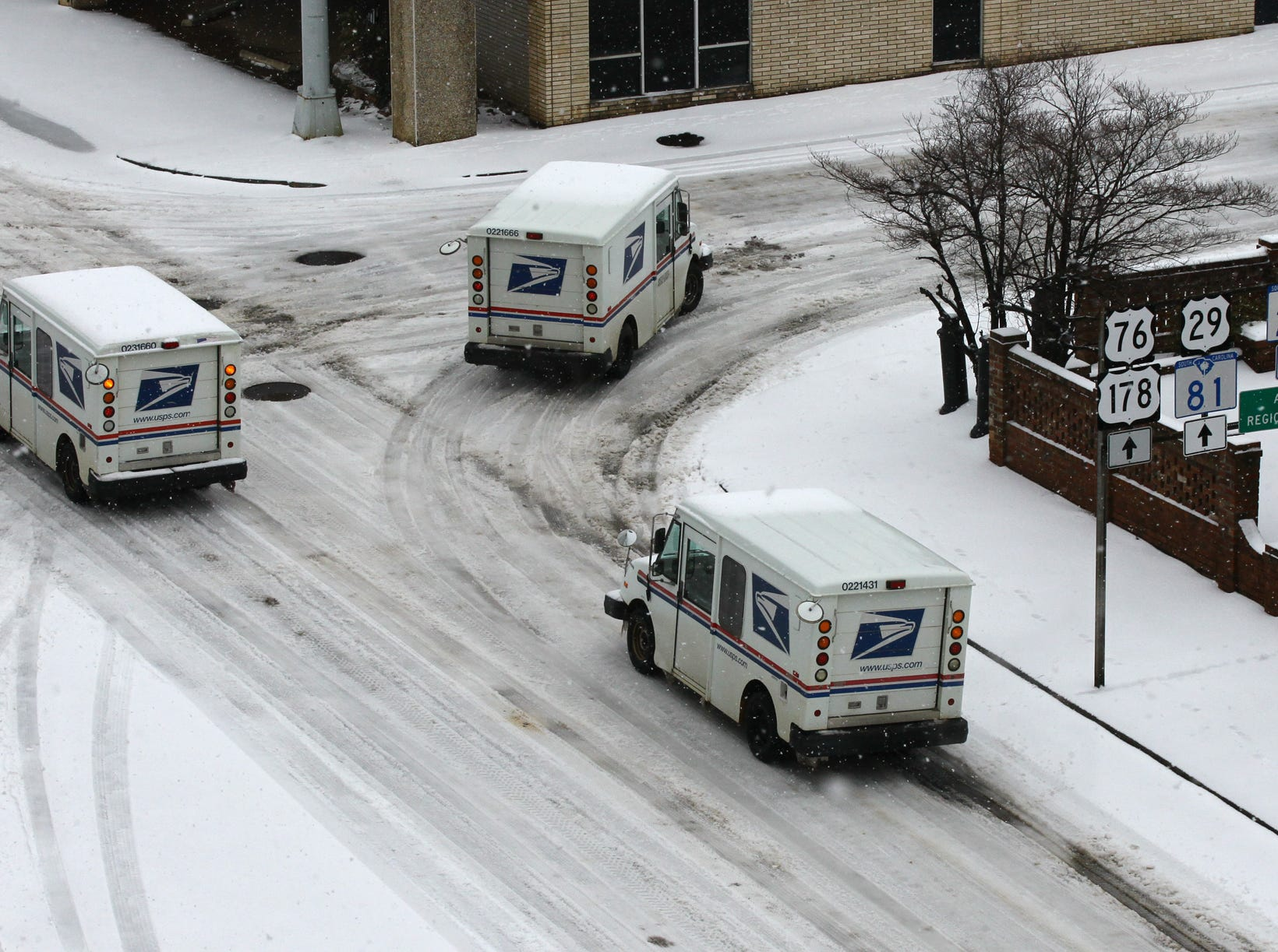 United States Post Office mail workers deliver mail despite the snow covered roads in Andersonduring the first snow of 2014.