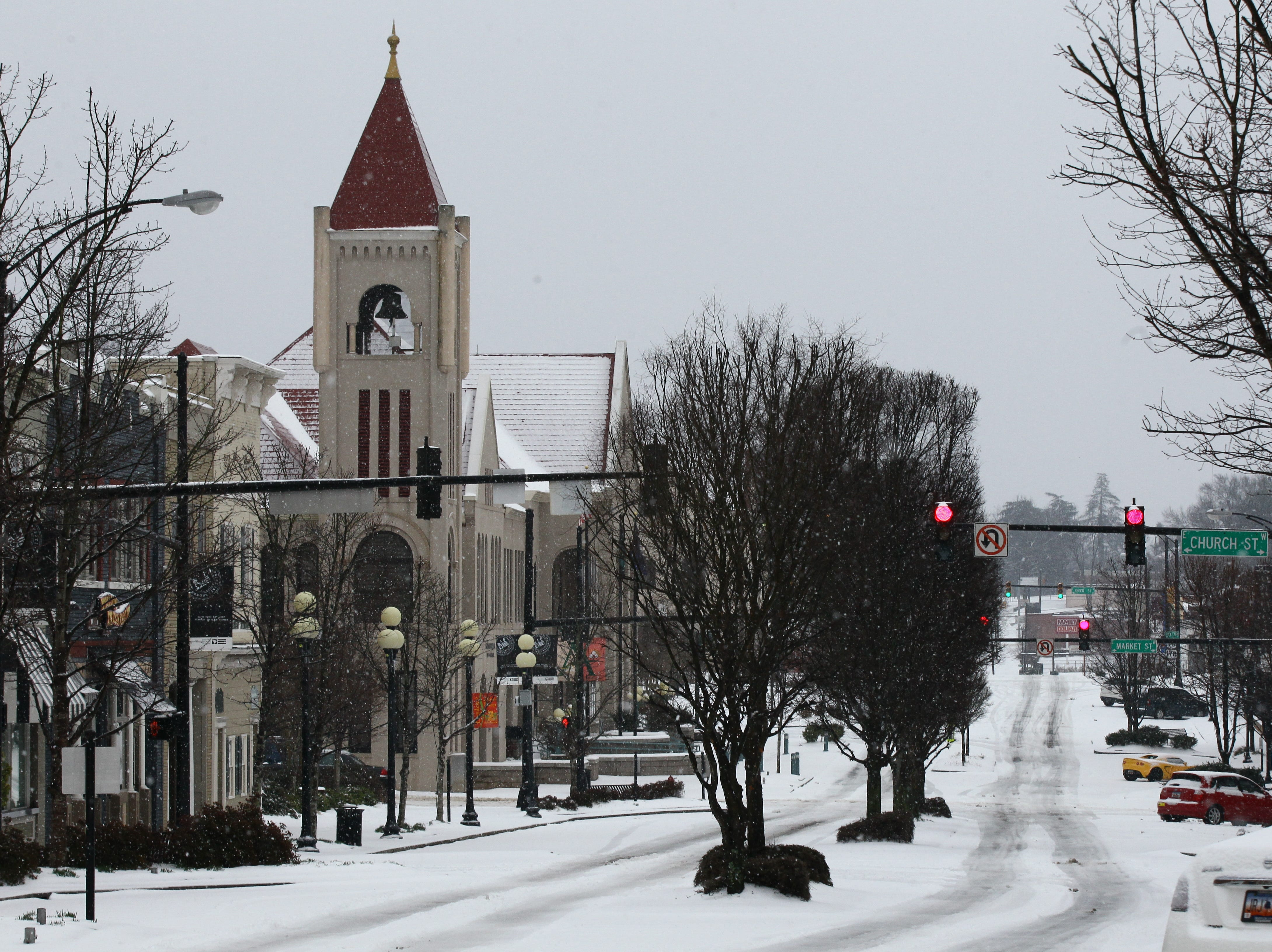 Snow covers South Main Street in view of city hall during the first snow of 2014.